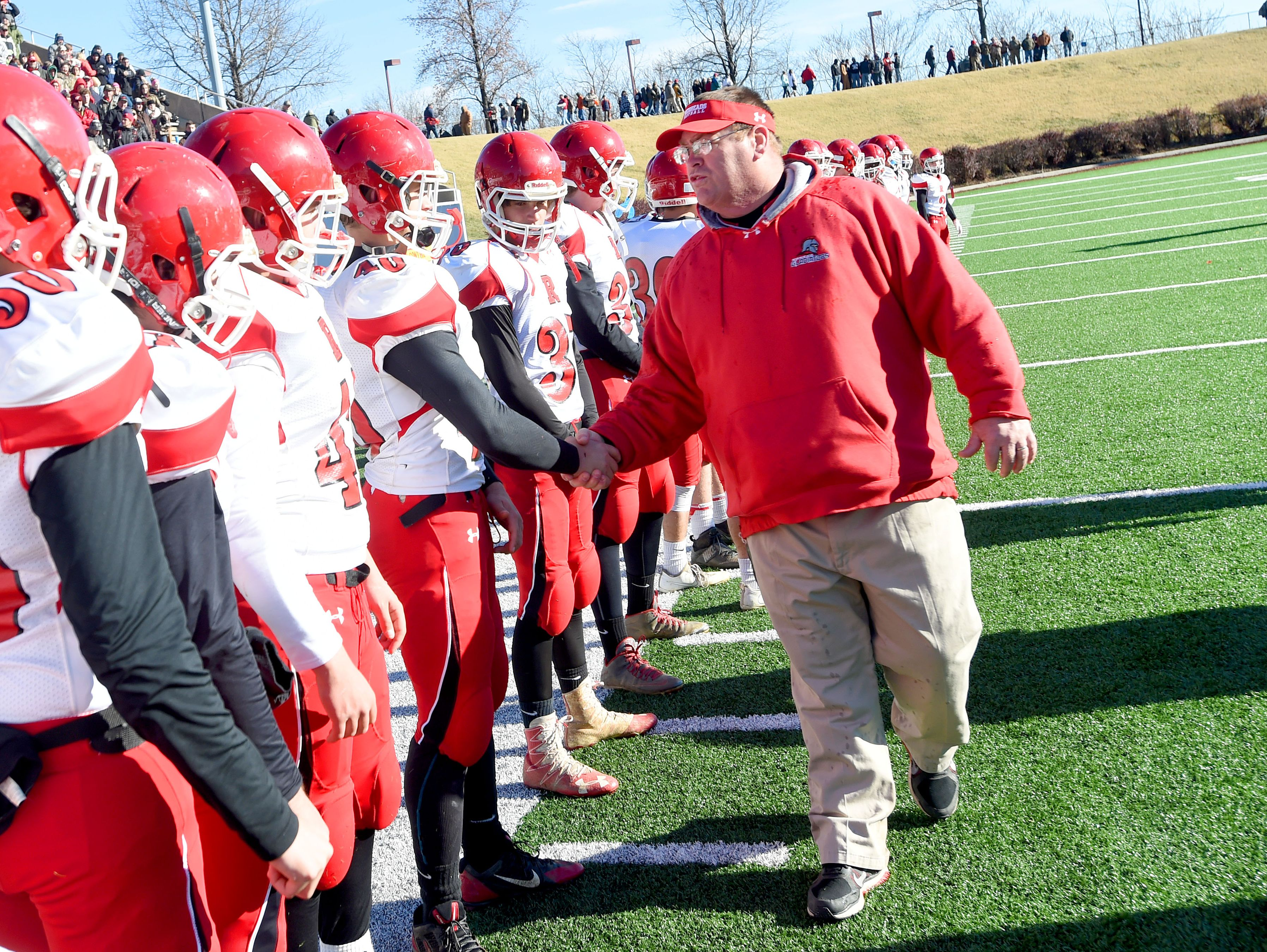 Riverheads' head coach Robert Casto shakes the hand of each and every player following their win over Sussex Central to win the Group 1A state championship.