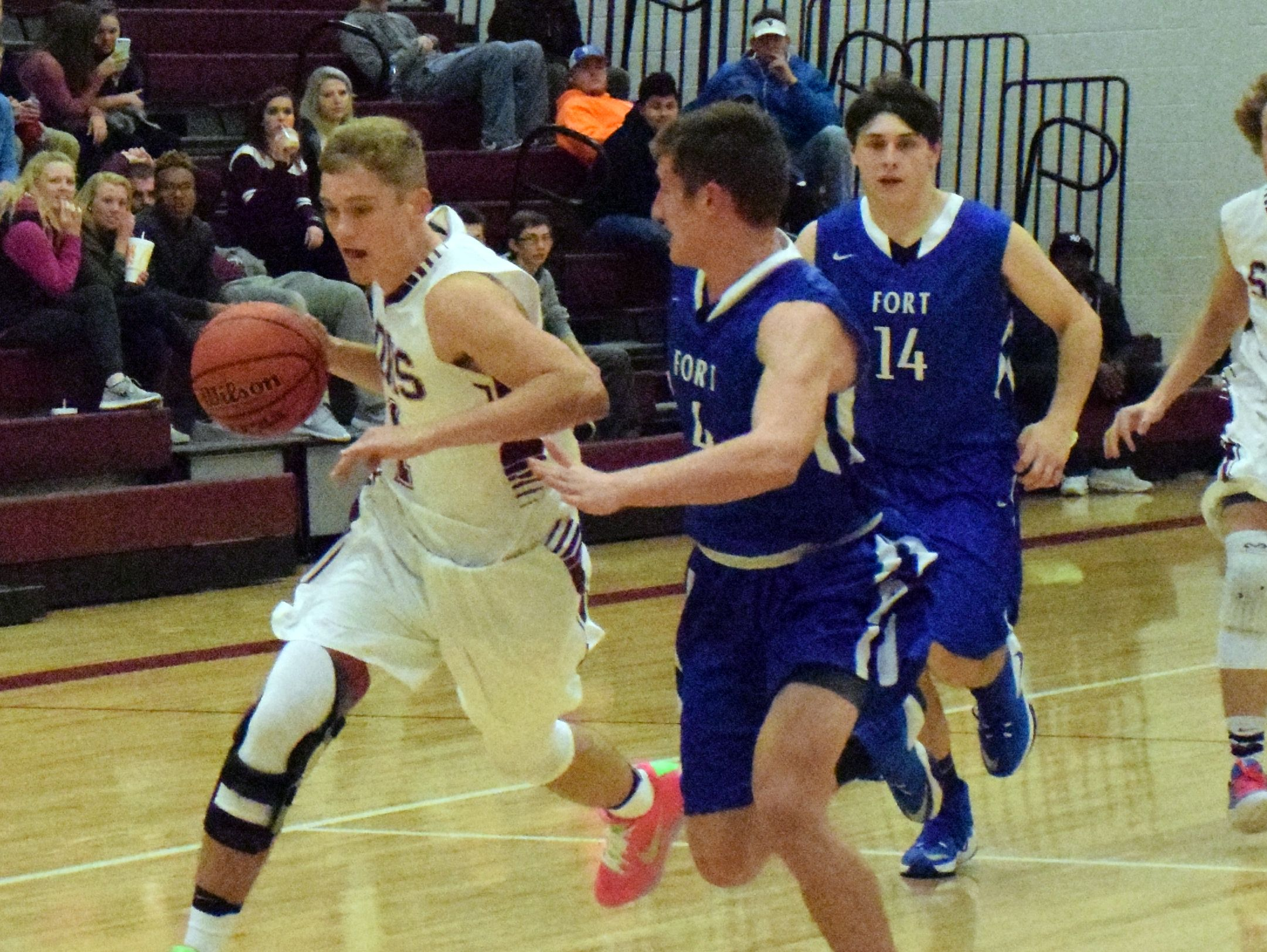 Stuarts Draft's Carson Peck, left, drives on Fort Defiance's Patton Fitzwater during the first half of their boys basketball game on Tuesday, Dec. 13, 2016, at Stuarts Draft High School in Stuarts Draft, Va.