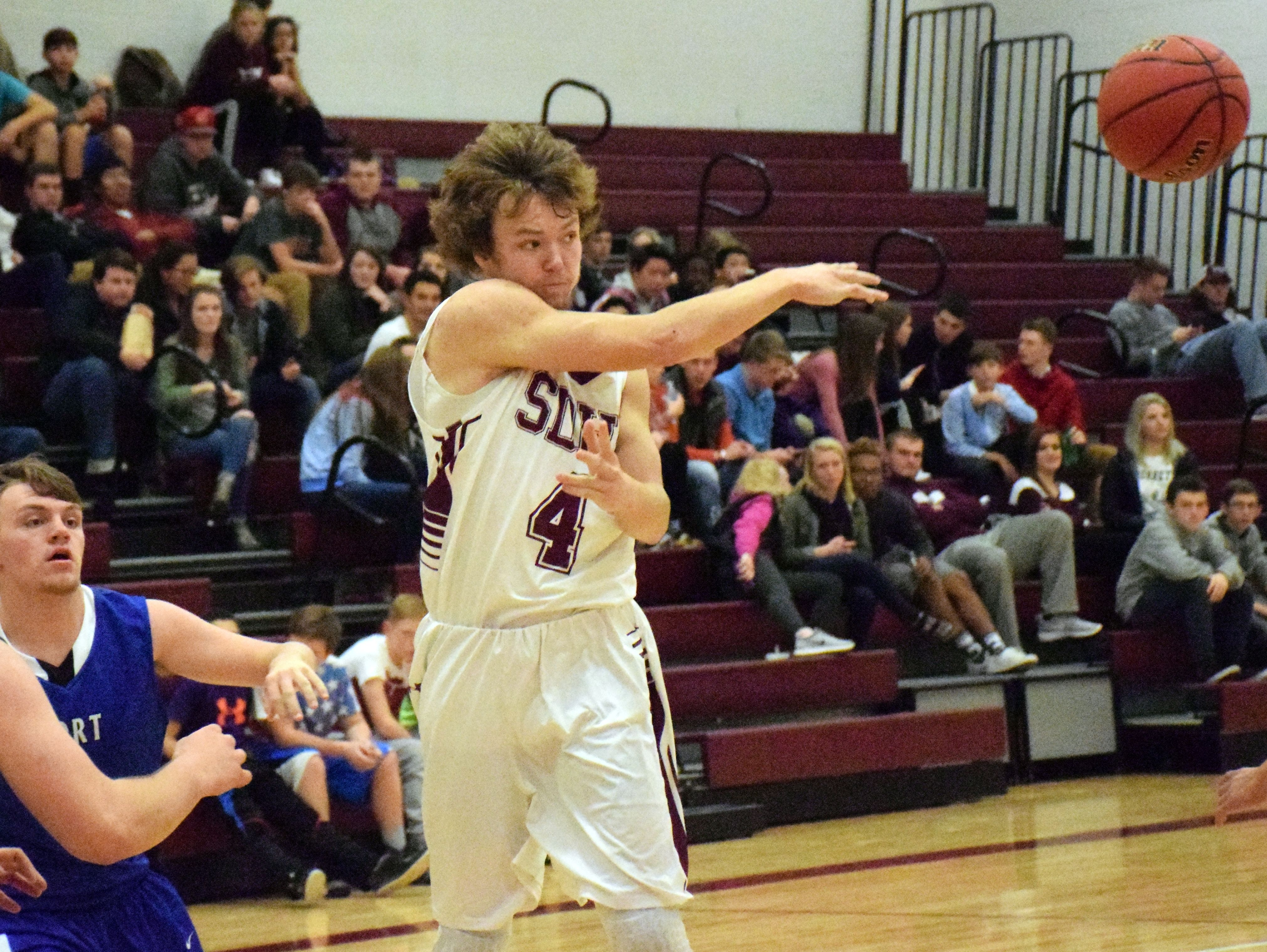 Stuarts Draft's Dalton McGann, left, makes a pass to a teammate during the first half of the Cougars' boys basketball game against Fort Defiance on Tuesday, Dec. 13, 2016, at Stuarts Draft High School in Stuarts Draft, Va.