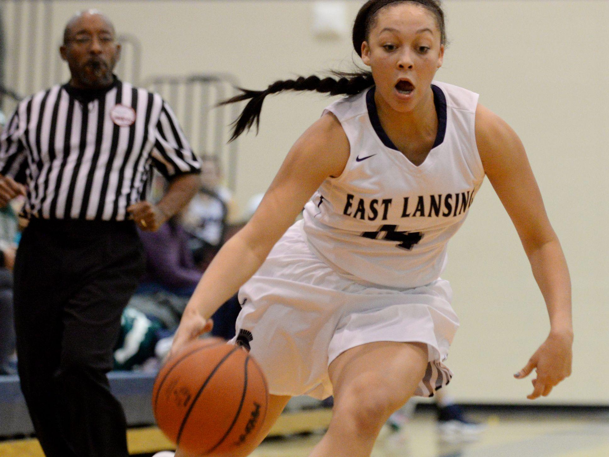 East Lansing's Aazhenii Nye runs the ball down the court during the game against Haslett on Tuesday, Dec. 13, 2016 at East Lansing High School. East Lansing won, 60-50.
