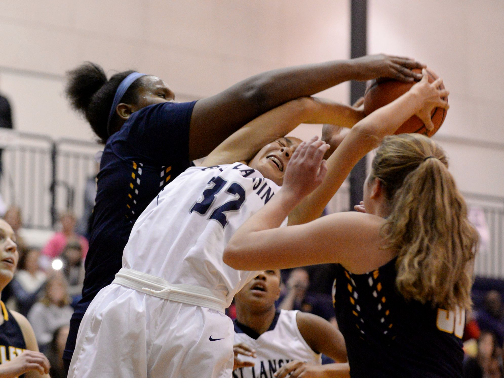 East Lansing's Aaliyah Nye and Haslett's Imania Baker go up for the rebound during the game against Haslett on Tuesday, Dec. 13, 2016 at East Lansing High School. East Lansing won, 60-50.