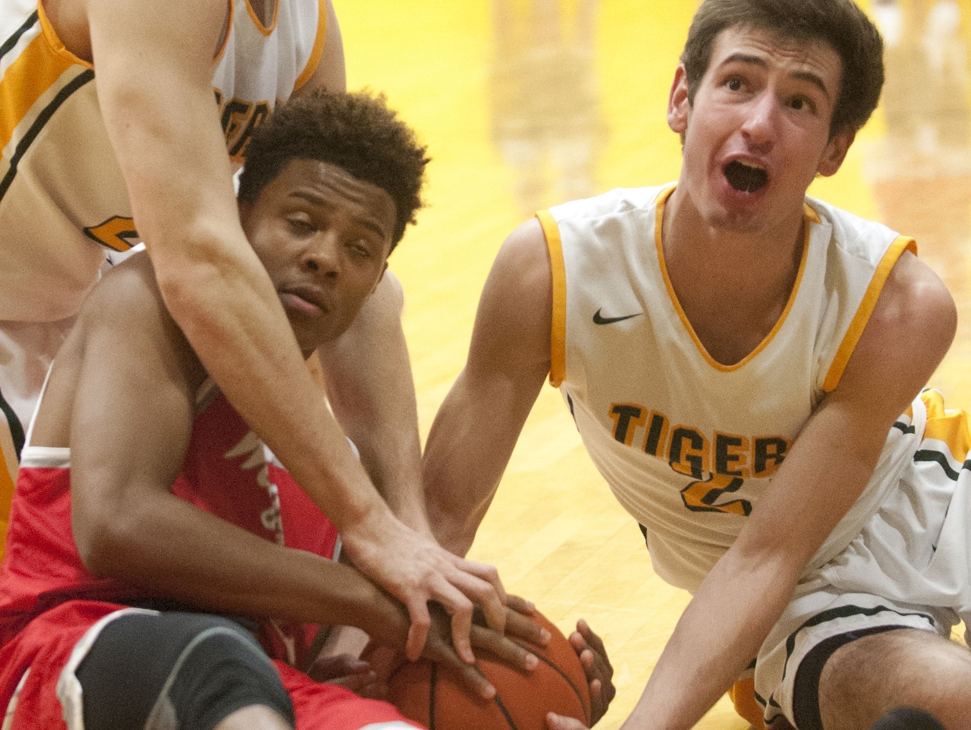 St. Xavier forward Jake Wehder, Waggener guard Ron Fell and St. Xavier forward Paul Oberst, right, tie up a loose ball. 13 December 2016
