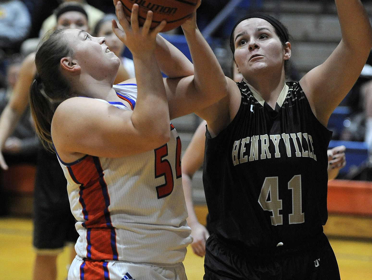 Silver Creek's Savannah O'Neil (left) shoots against Henryville's Kennedy Easton (41) on Tuesday at Silver Creek High School. (Photo by David Lee Hartlage, Special to The Courier-Journal) Dec. 13, 2016