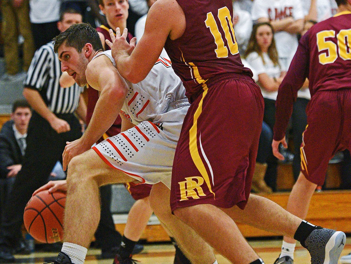 Washington's Isaac Goeman (42) pushes past Roosevelt's Coby Nofziger (10) during a game Tuesday, Dec. 13, 2016, at Washington High School in Sioux Falls.