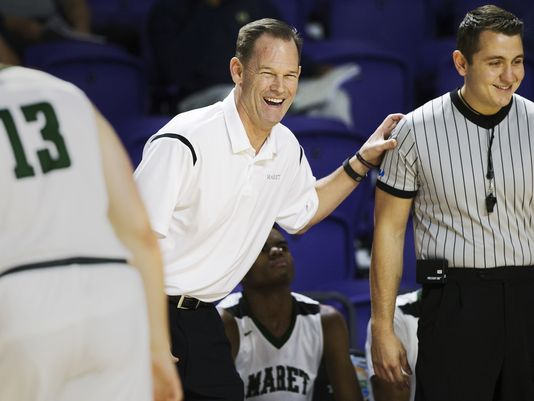 Maret High School coach Chuck Driesell leads his team against Hudson Cathloic during play Friday at the Culligan City of Palms Classic at the Suncoast Credit Union Arena in Fort Myers. Hudson beat Maret 65-51. (Photo: Kinfay Moroti/news-press.com)