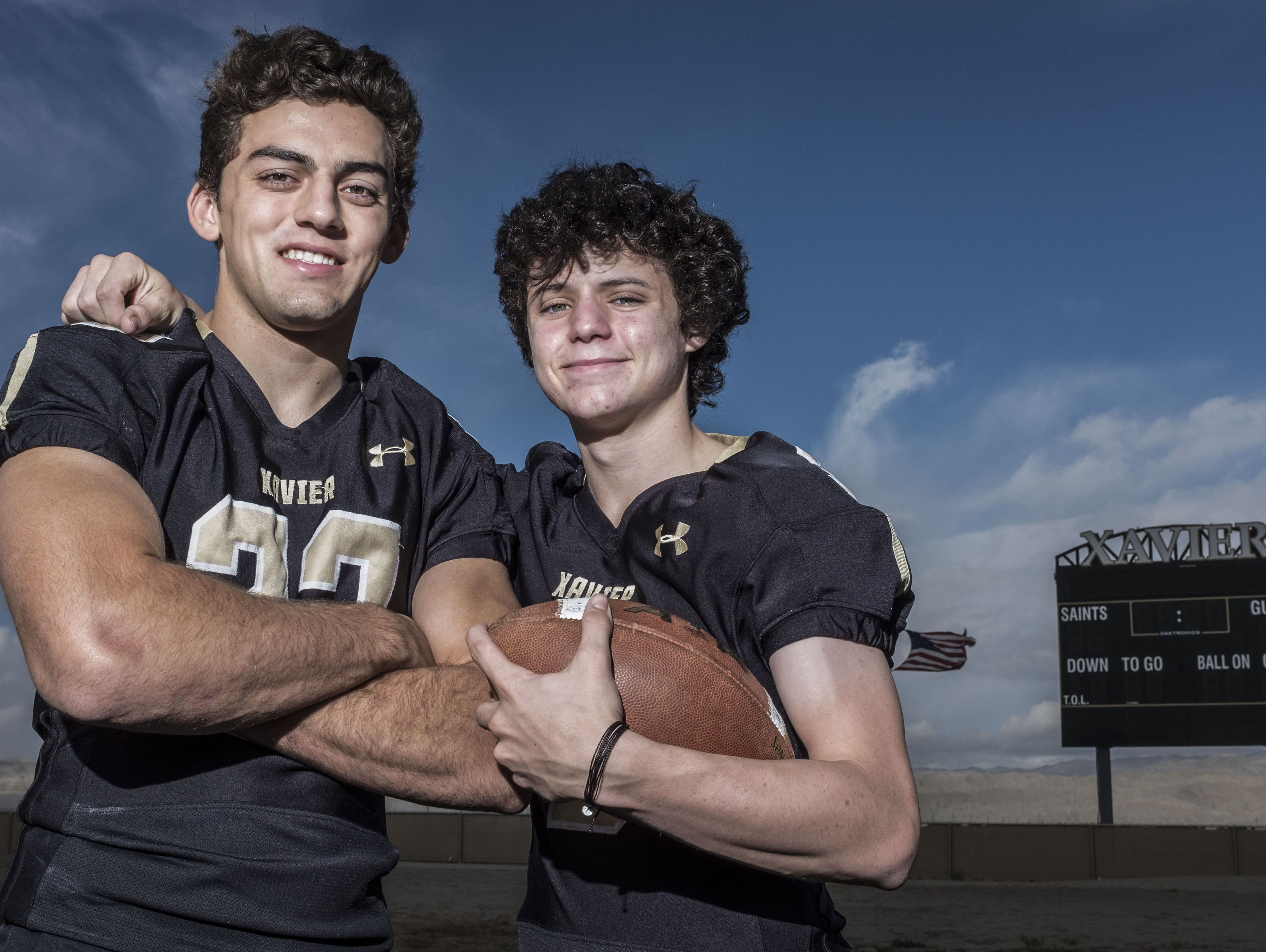 Saints football players Chandler Barbato, right, and Mason Sarna at Xavier College Prep in Palm Desert on Friday, December 16, 2016.