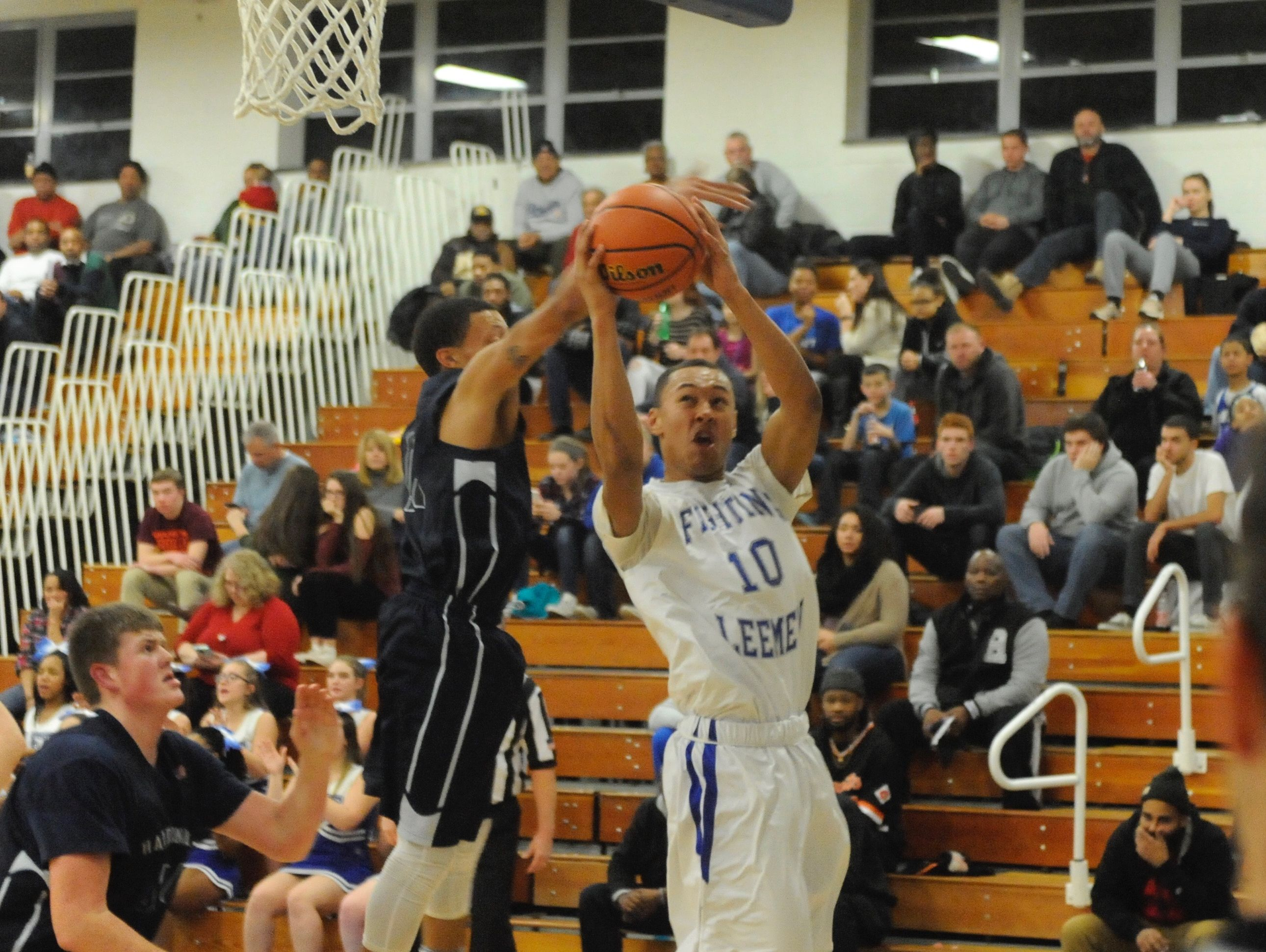 Lee High's Jarvis Vaughan (10) goes in for a layup during Friday night's game versus Harrisonburg at Paul Hatcher Gym.