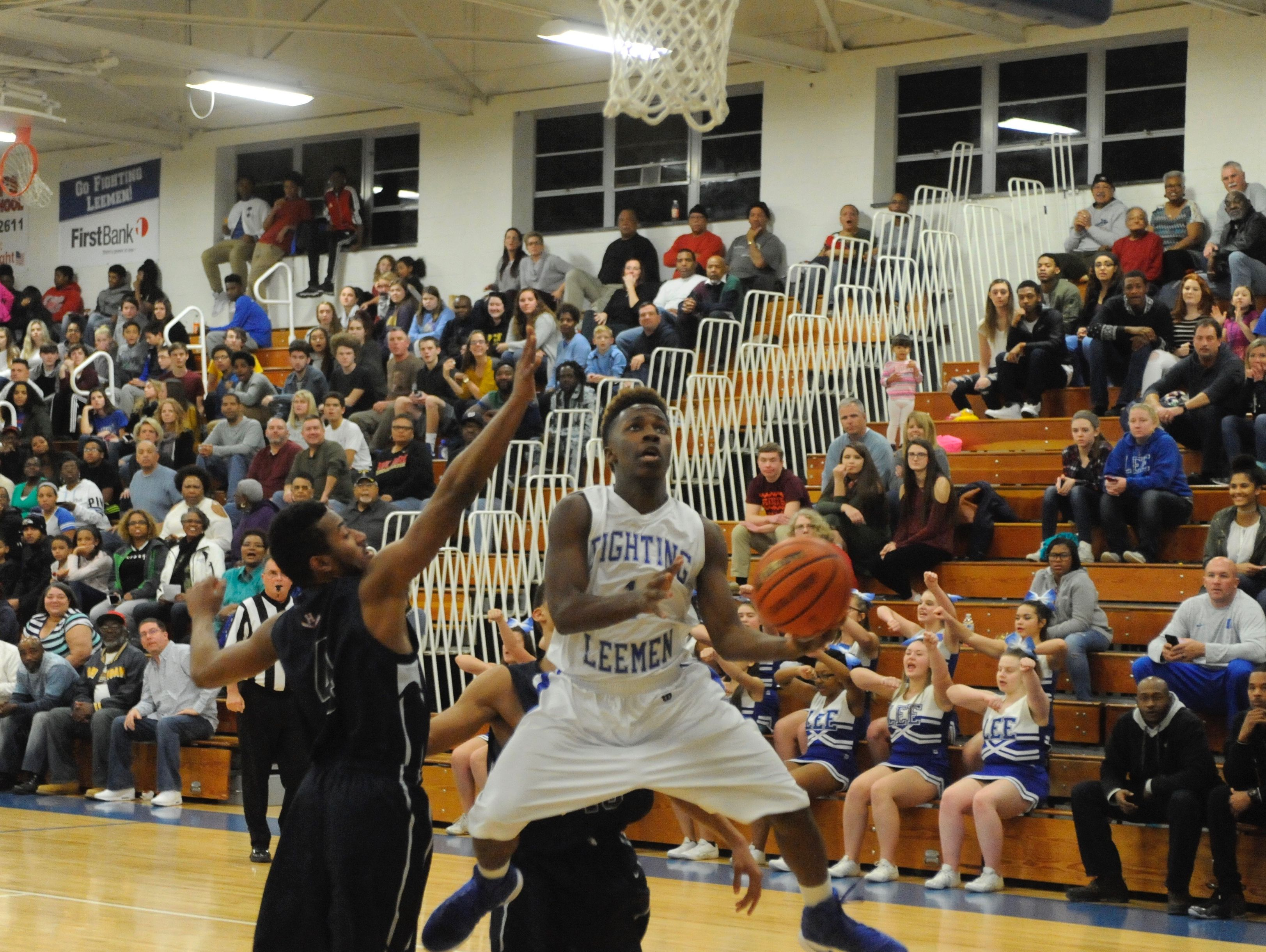 Lee High's Blaize Velvin attempts a shot during Friday night's game against Harrisonburg at Paul Hatcher Gym.