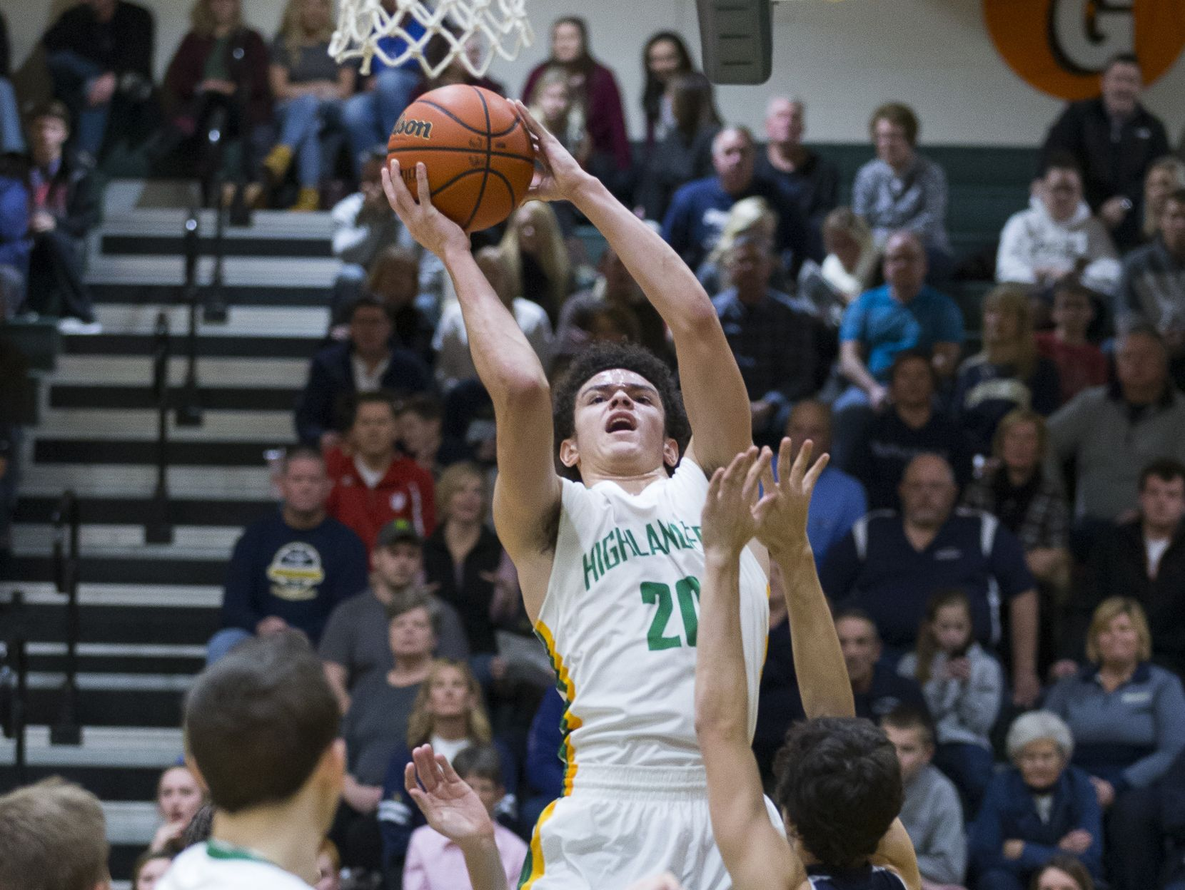 Floyd Central High School forward Cobie Barnes (20) shoots the ball during the game between Floyd Central and Providence at Floyd Central High School.