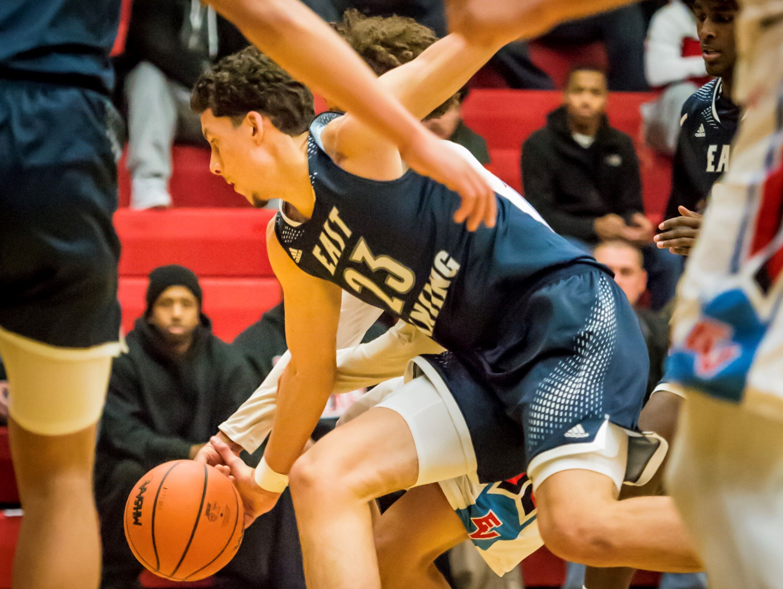 Brandon Johns, 23, of East Lansing steals the ball from Jonny Bowers of Everett during their game Friday December 16, 2016 in Lansing.