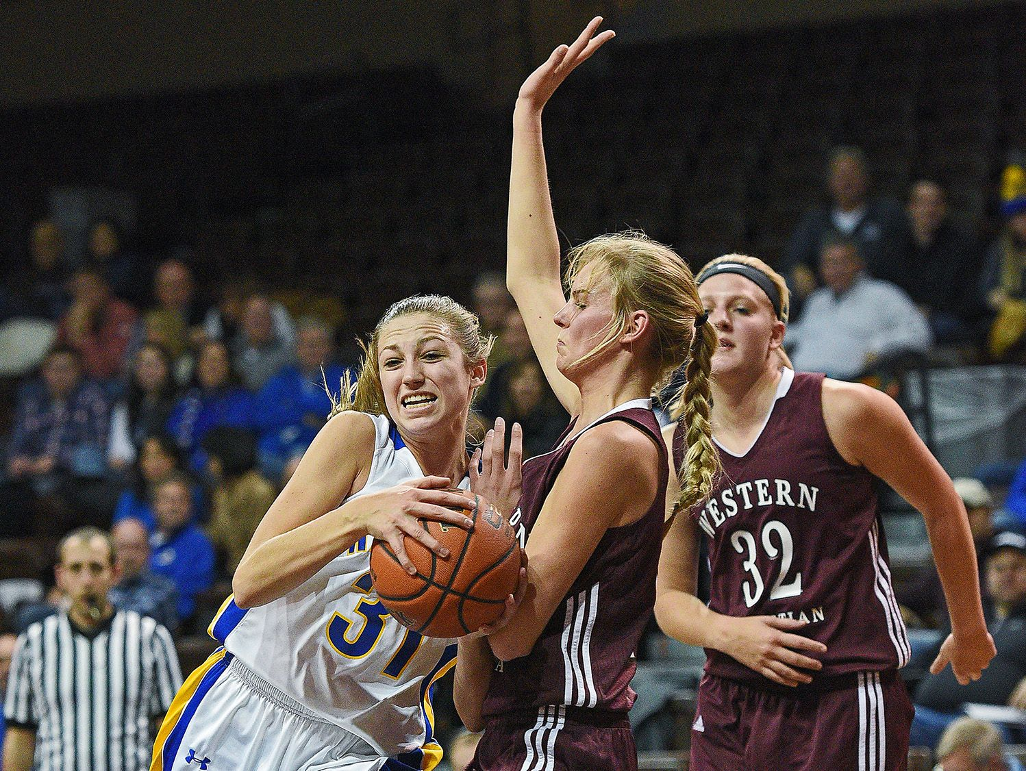 O'Gorman's Emma Ronsiek (31) pushes past Western Christian's Jessi DeJager (10) during the Edith Sanford Breast Center Girls Pentagon Classic Saturday, Dec. 17, 2016, at the Sanford Pentagon in Sioux Falls.