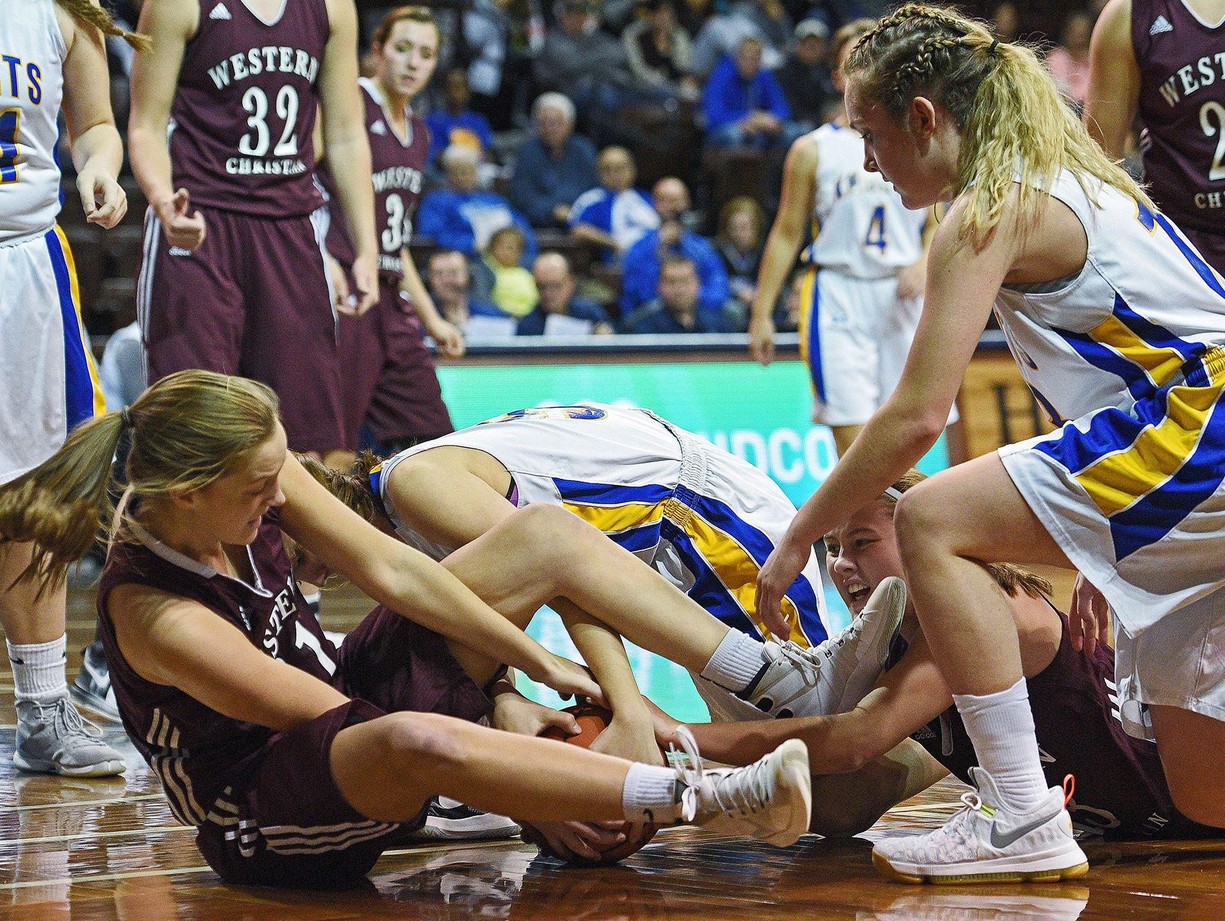 O'Gorman and Western Christian players struggle for the ball during the Edith Sanford Breast Center Girls Pentagon Classic Saturday, Dec. 17, 2016, at the Sanford Pentagon in Sioux Falls.