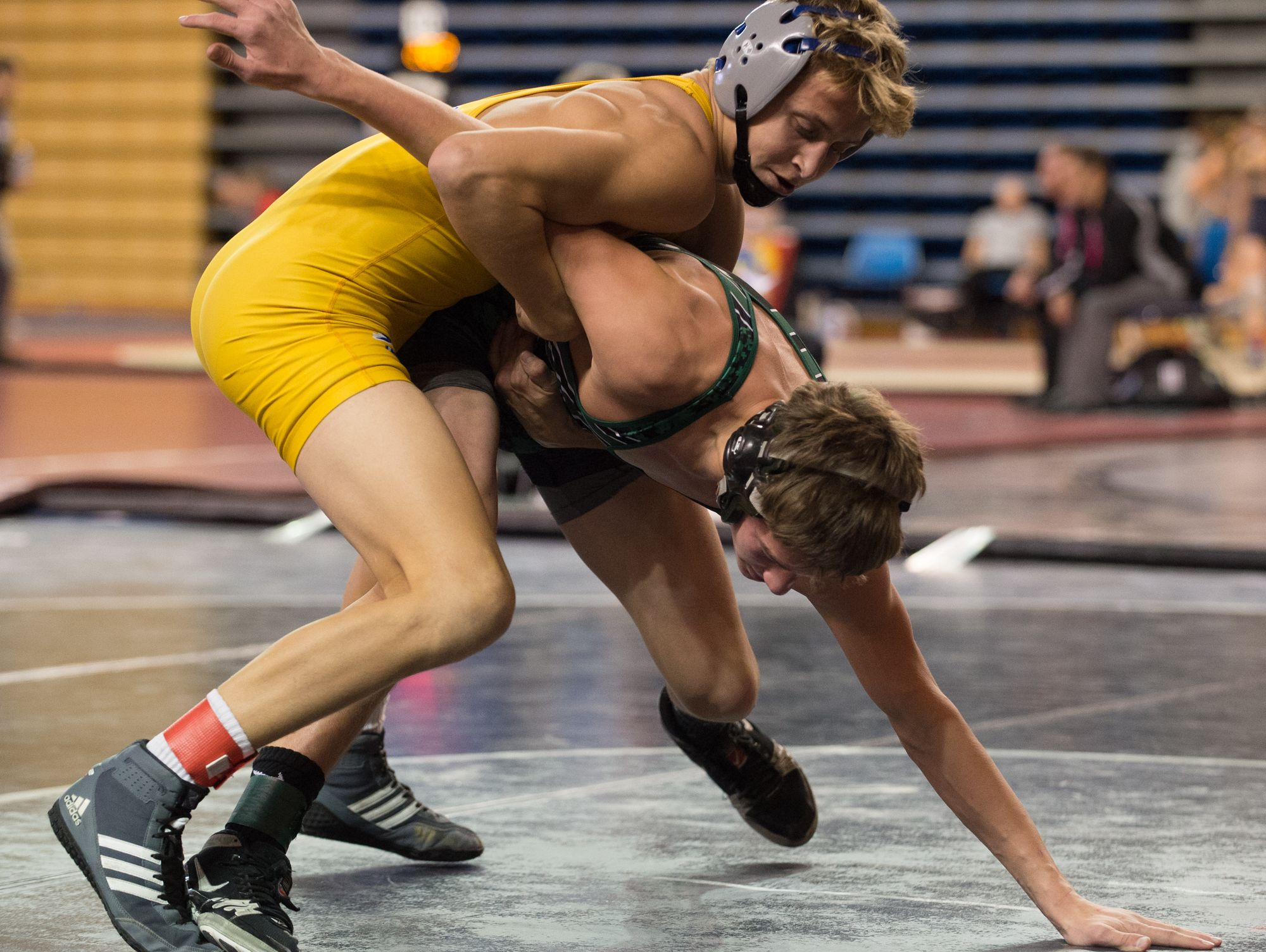 Caesar Rodney's Cameron Hayes, left, grabs the arm of Camden Catholic's Lucas Revano in the 120 pound match during the Beast of the East wrestling tournament at the University of Delaware on Saturday.