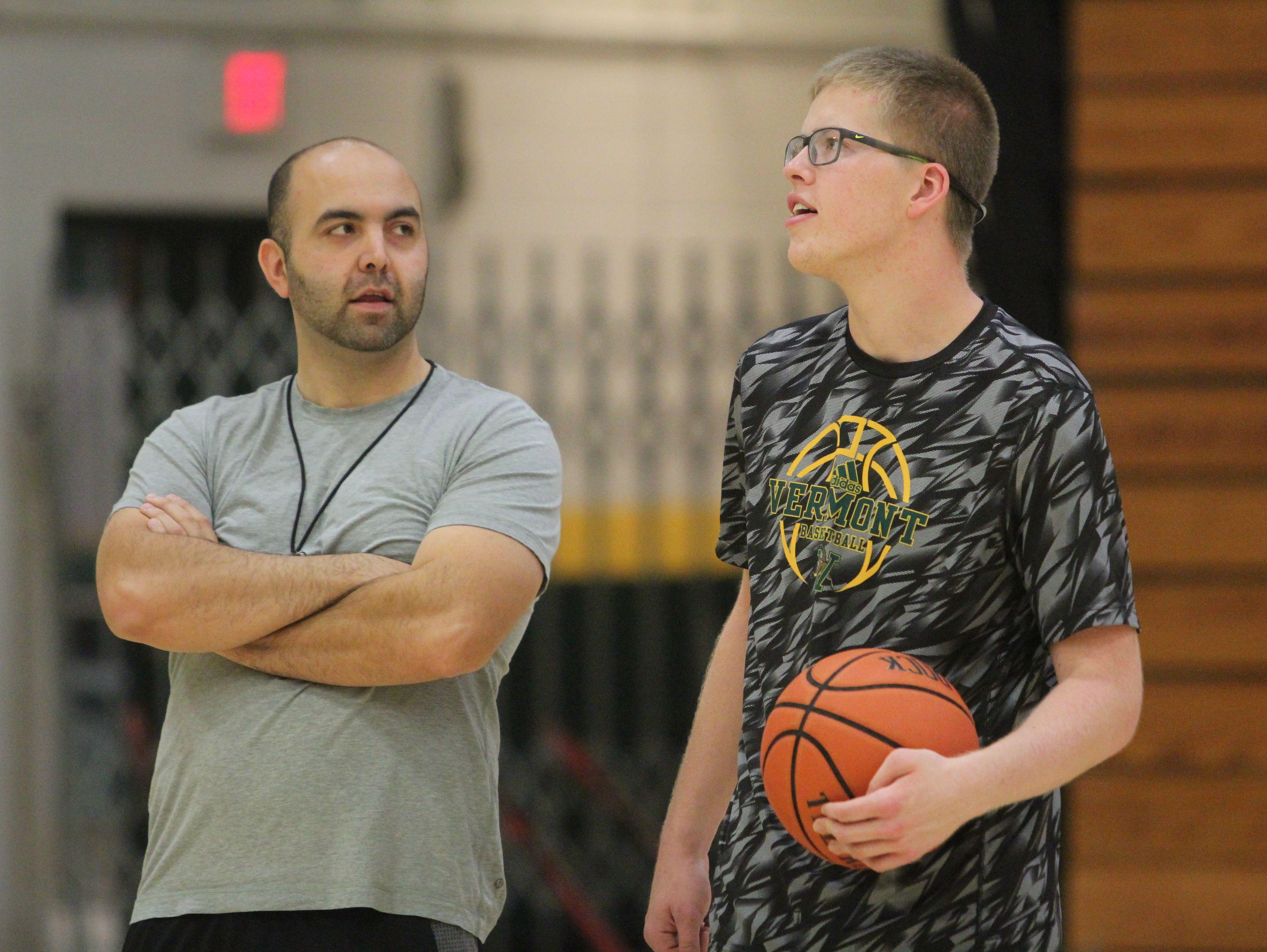 Josh Speidel with associate head coach Kyle Cieplicki.