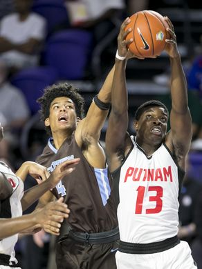 Alexis Yetna of Putnam and Westtown's Jake Forrester go up for a rebound (Photo: Amanda Inscore, News-Press)