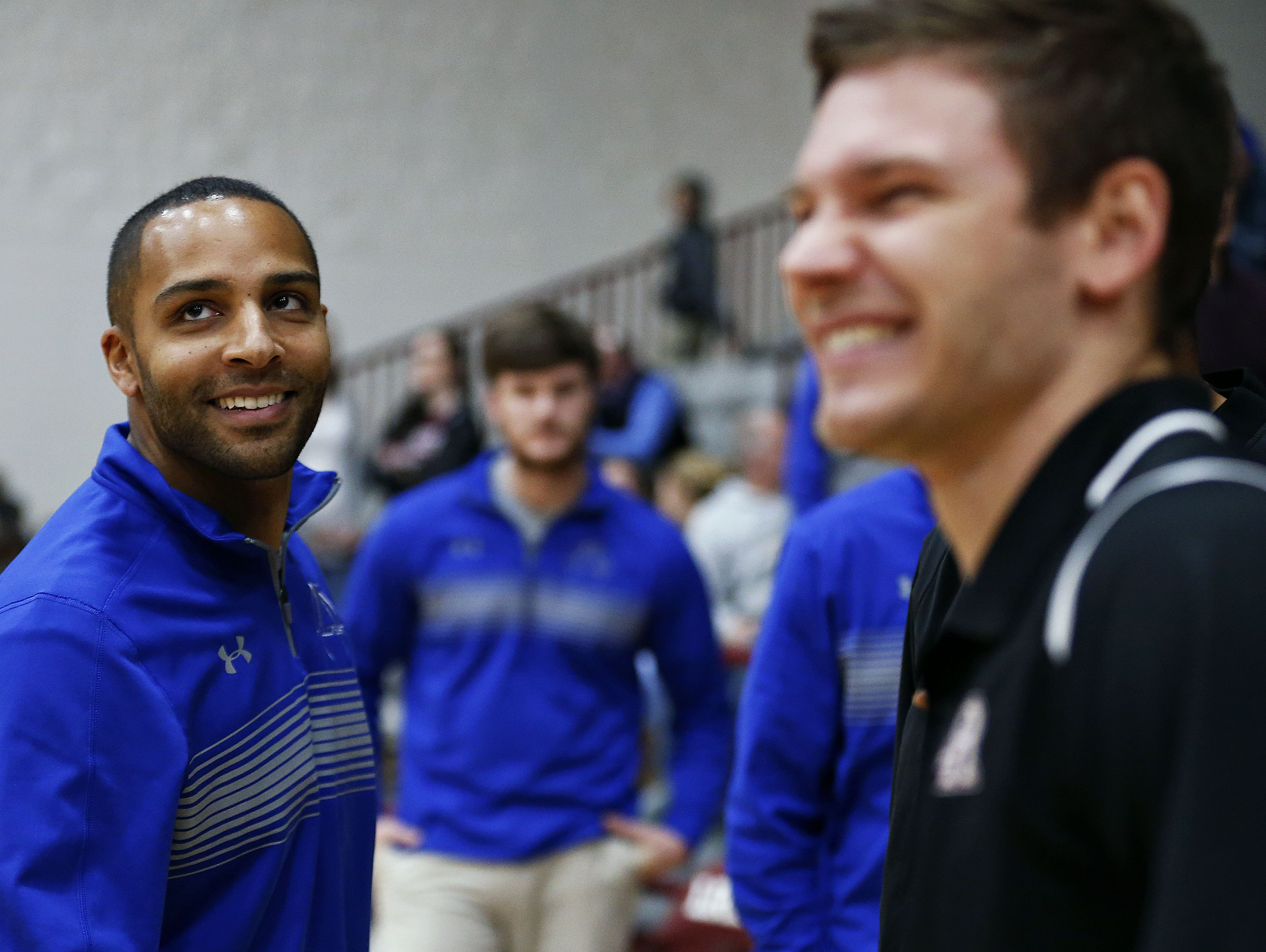 Hillcrest Hornets head coach Joel Brown, left, and Logan Rogersville Wildcats head coach Mitch McHenry share a laugh prior to the start of the high school basketball game between the Hillcrest Hornets and the Logan-Rogersville Wildcats at Logan-Rogersville High School in Rogersville, Mo. on Dec. 20, 2016.