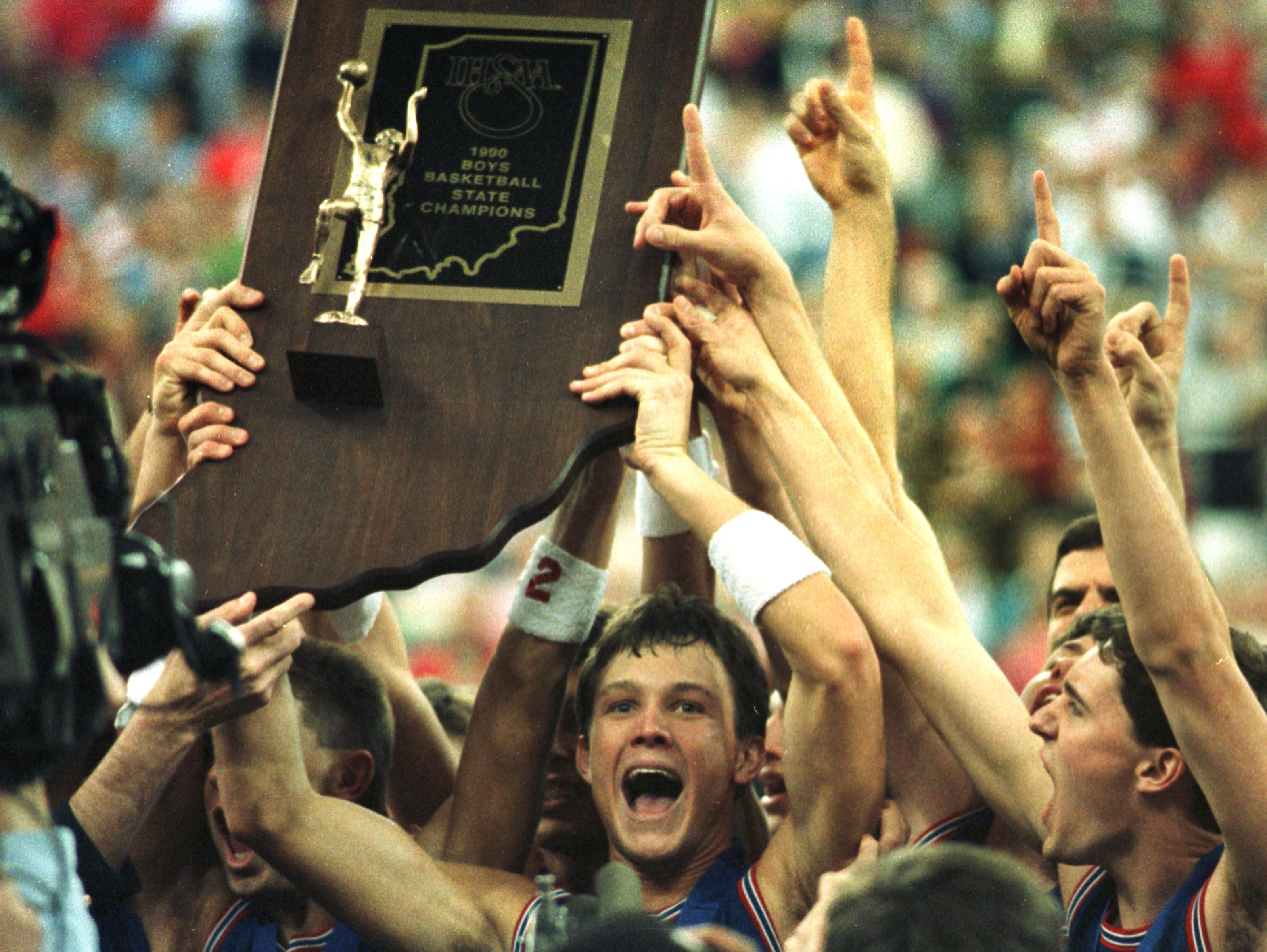 March 1990, Damon Bailey holds up the boys basketball championship trophy after leading his team, Bedford North Lawrence, to a state finals victory at the Hoosier Dome. (Mike Fender Photo/ The Indianapolis News)