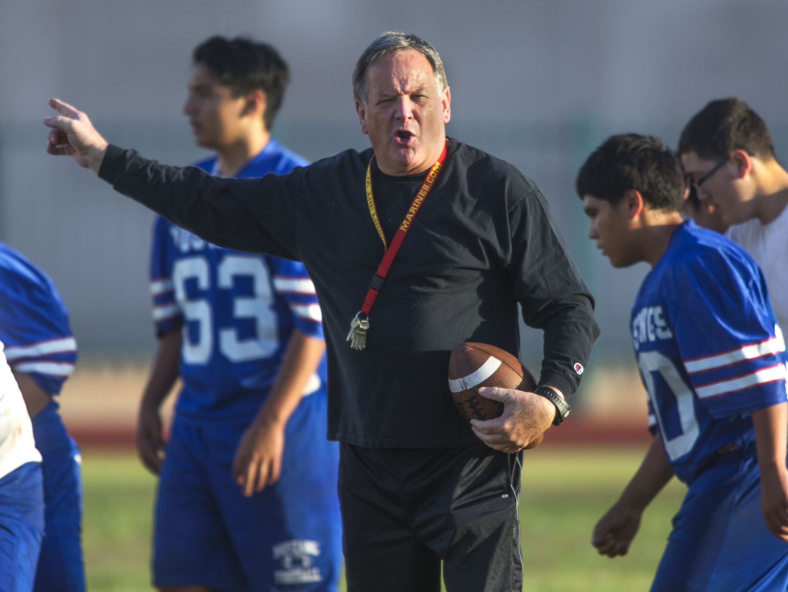 """Phoenix North High football coach Bernie Busken served three one-day suspensions without pay for a Sept. 29 incident in which he """"endangered a student's well-being and safety,"""" according to a three-page report in Busken's personnel file."""