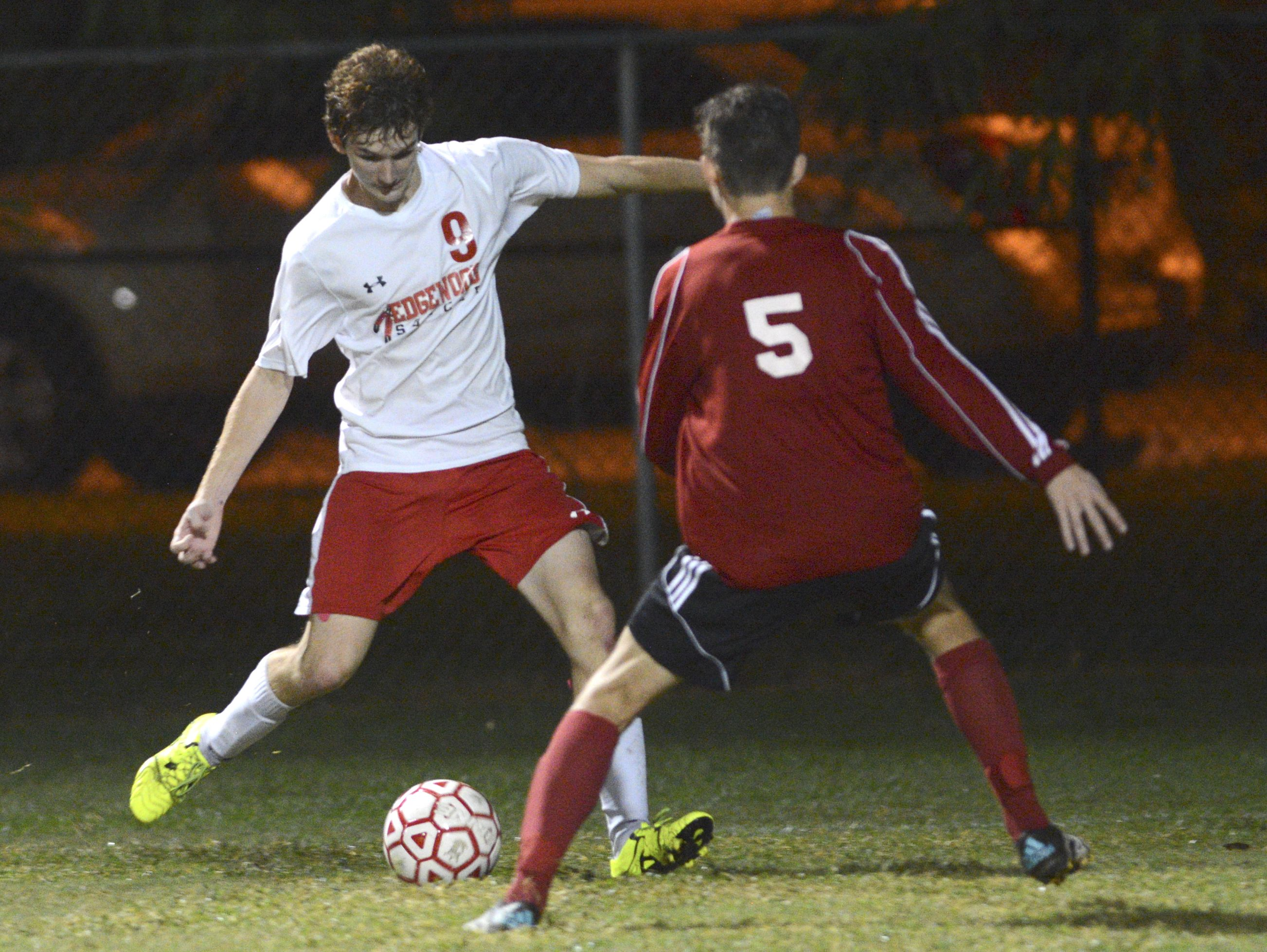 Edgewood's Christian Yates takes a shot at the goal past Vero Beach defender Dunton Jaret during a recent game.