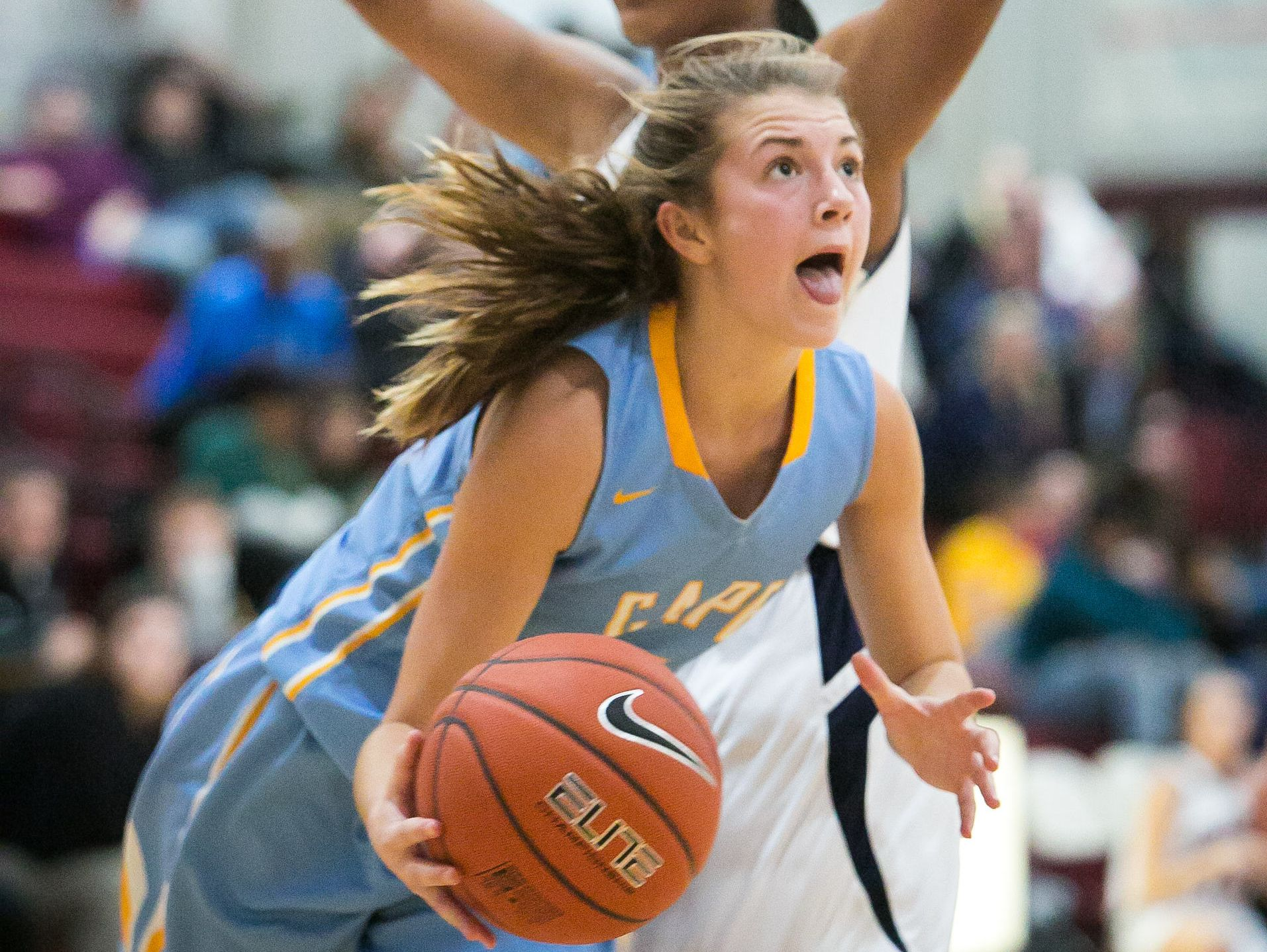 Cape Henlopen guard Alia Marshall dribbles around a defender and scores.