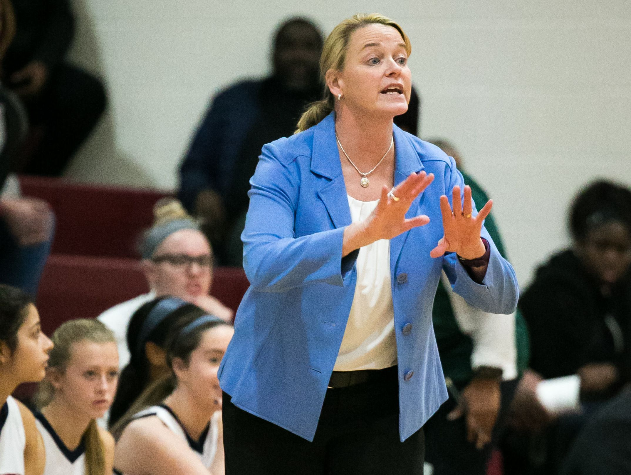 Wilmington Friends coach Carolyn Connors gestures to her players from courtside.