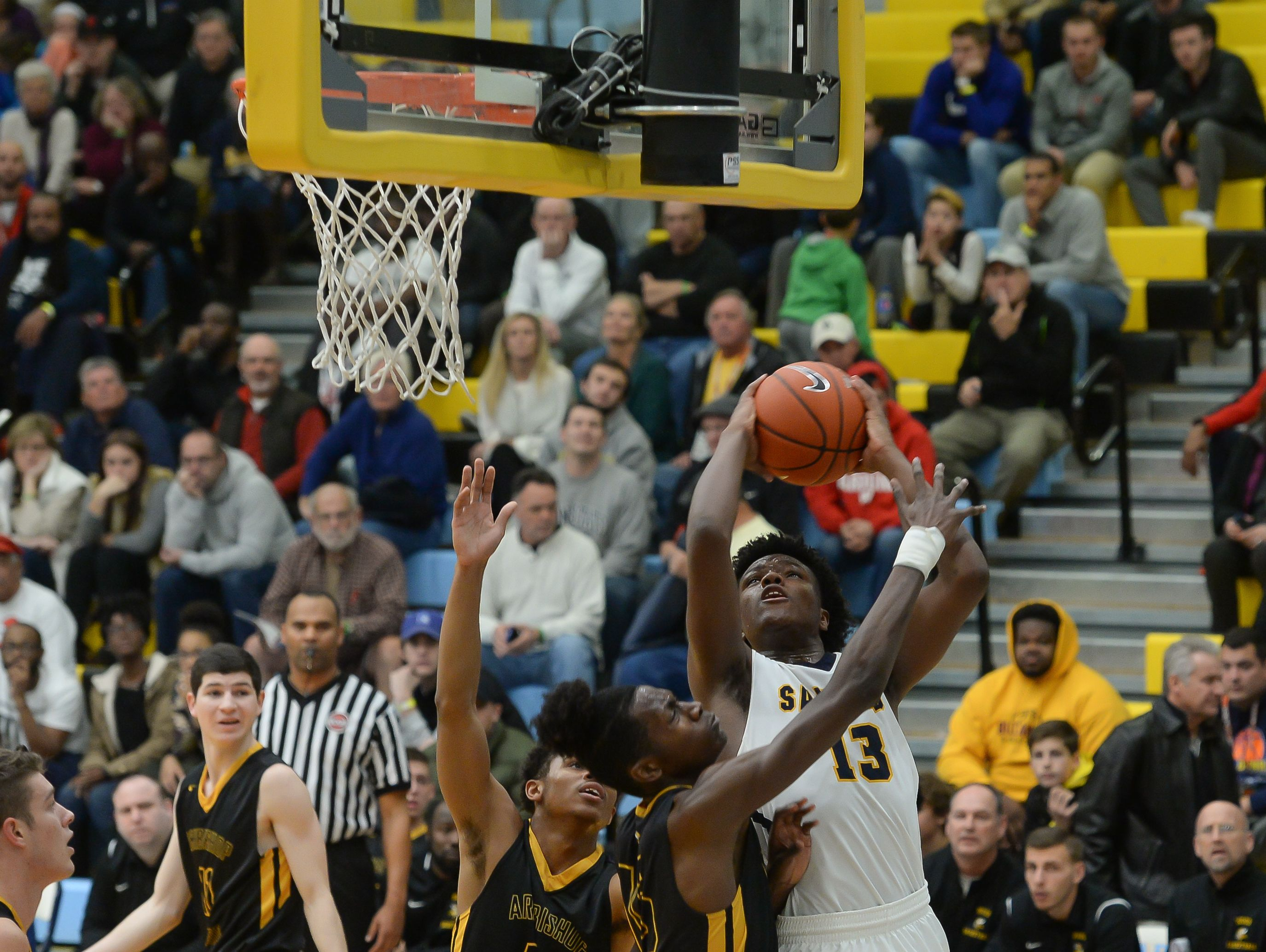 Sanford School's Jyare Davis with the jumper against Archbishop Wood during the Slam Dunk to the Beach on Wednesday, Dec 28, 2016. Final Score Sanford School- 47 ,Archbishop Wood- 72