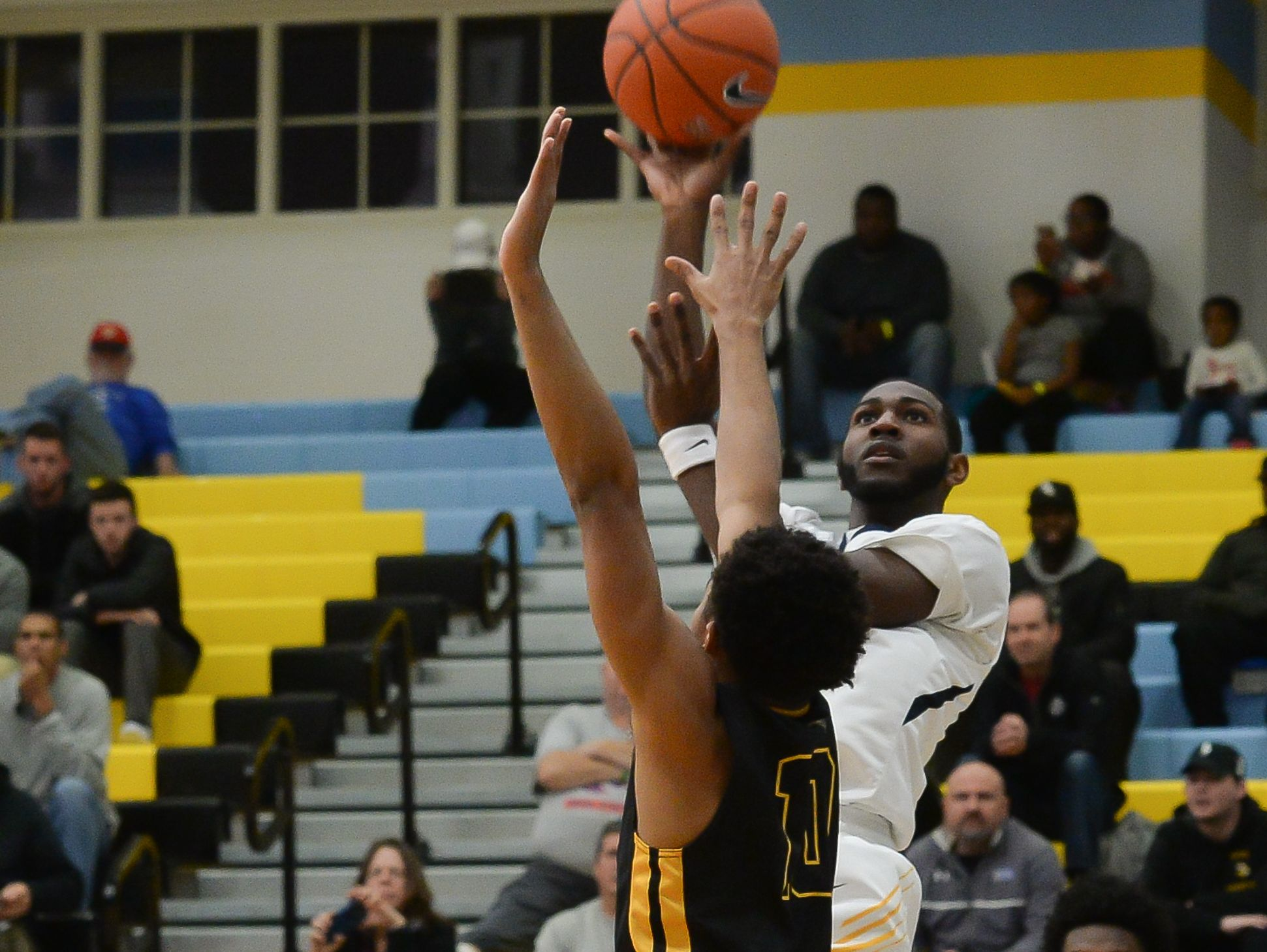 Sanford School's Marcus McCollum with the jumper over Archbishop Wood during the Slam Dunk to the Beach on Wednesday, Dec 28, 2016. Final Score Sanford School- 47 ,Archbishop Wood- 72