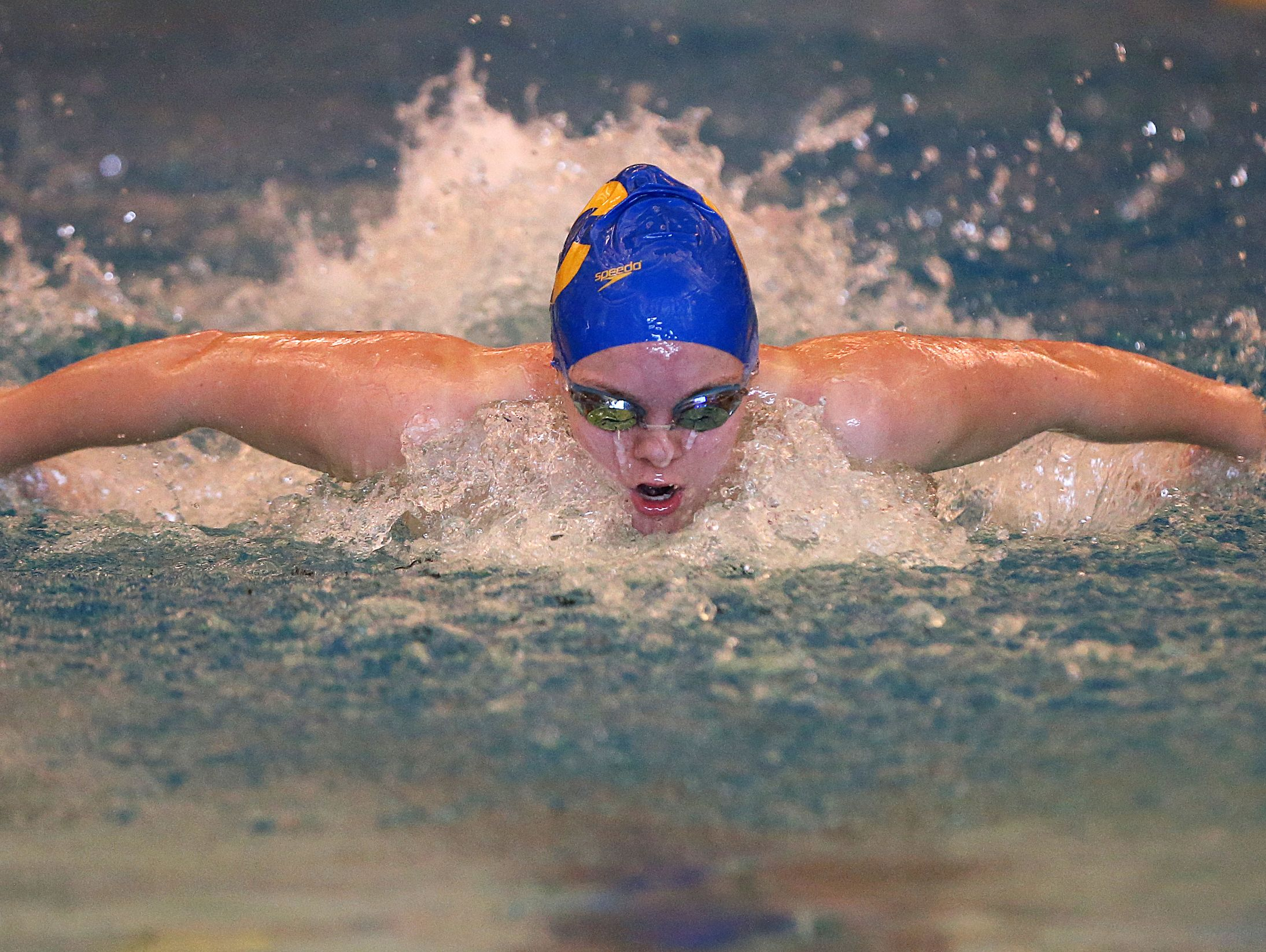 Carmel's Sammie Burchill won the 100 butterfly and 100 backstroke at Carmel High School, Wednesday in a triangular meet against Zionsville and Homestead.