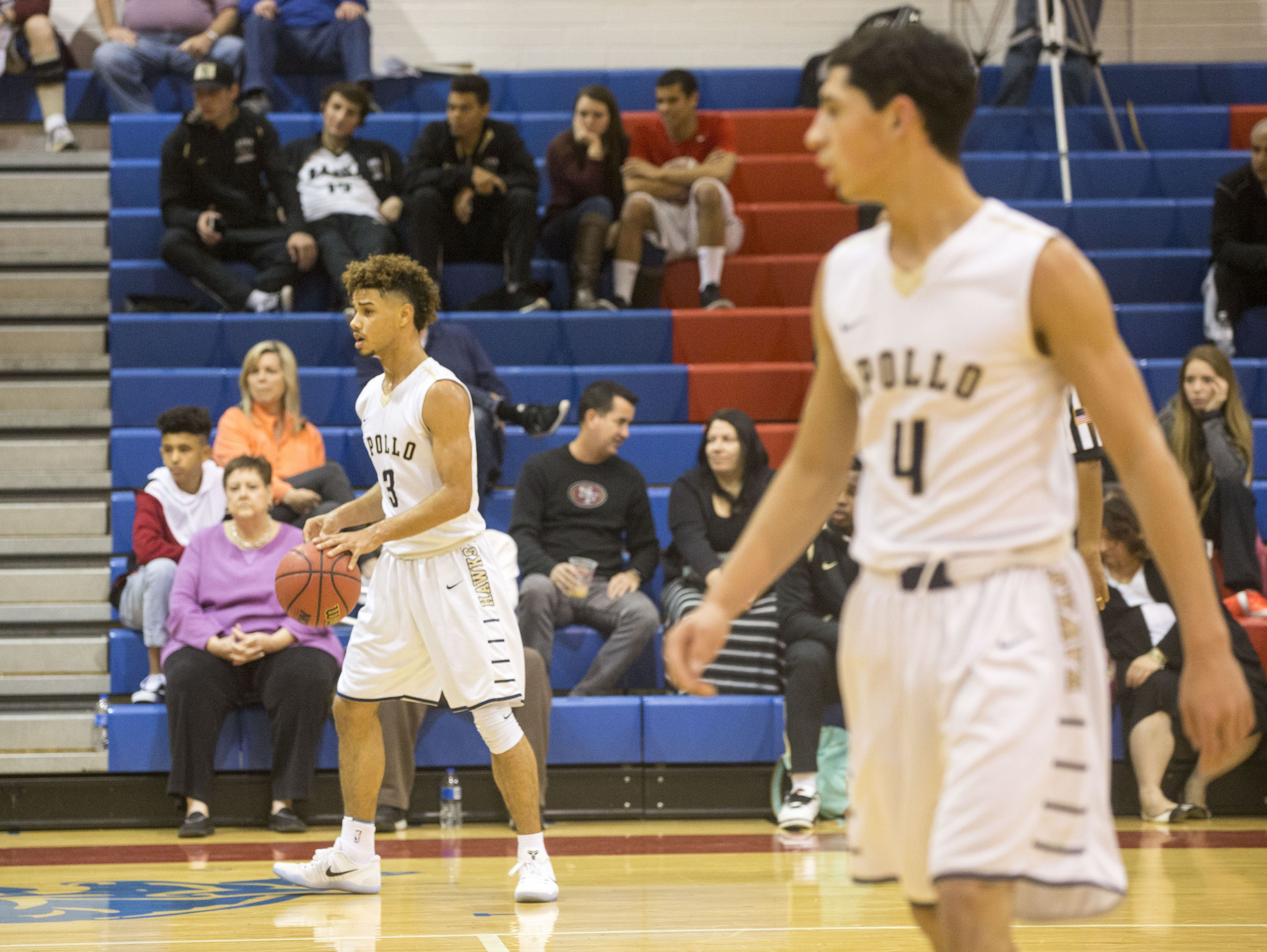 Apollo guards Holland Woods #3 and Dre Marin #4 play against Mountain Ridge at Mountain View High School.