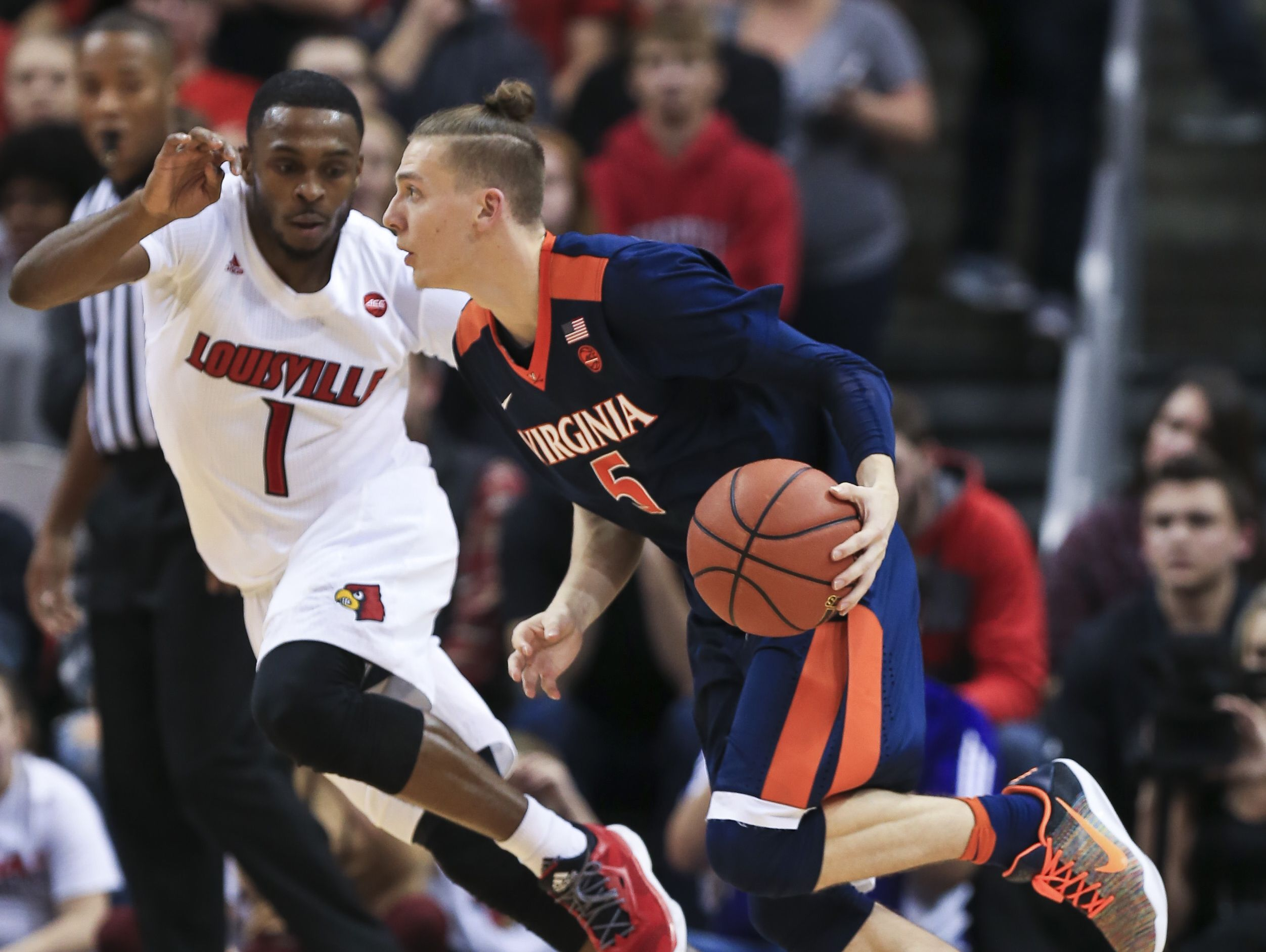 Virginia's Kyle Guy drives past Louisville's Tony Hicks as Guy had nine points in 19 minutes of play in the Cavaliers' win over the Cards 61-53 Wednesday night.
