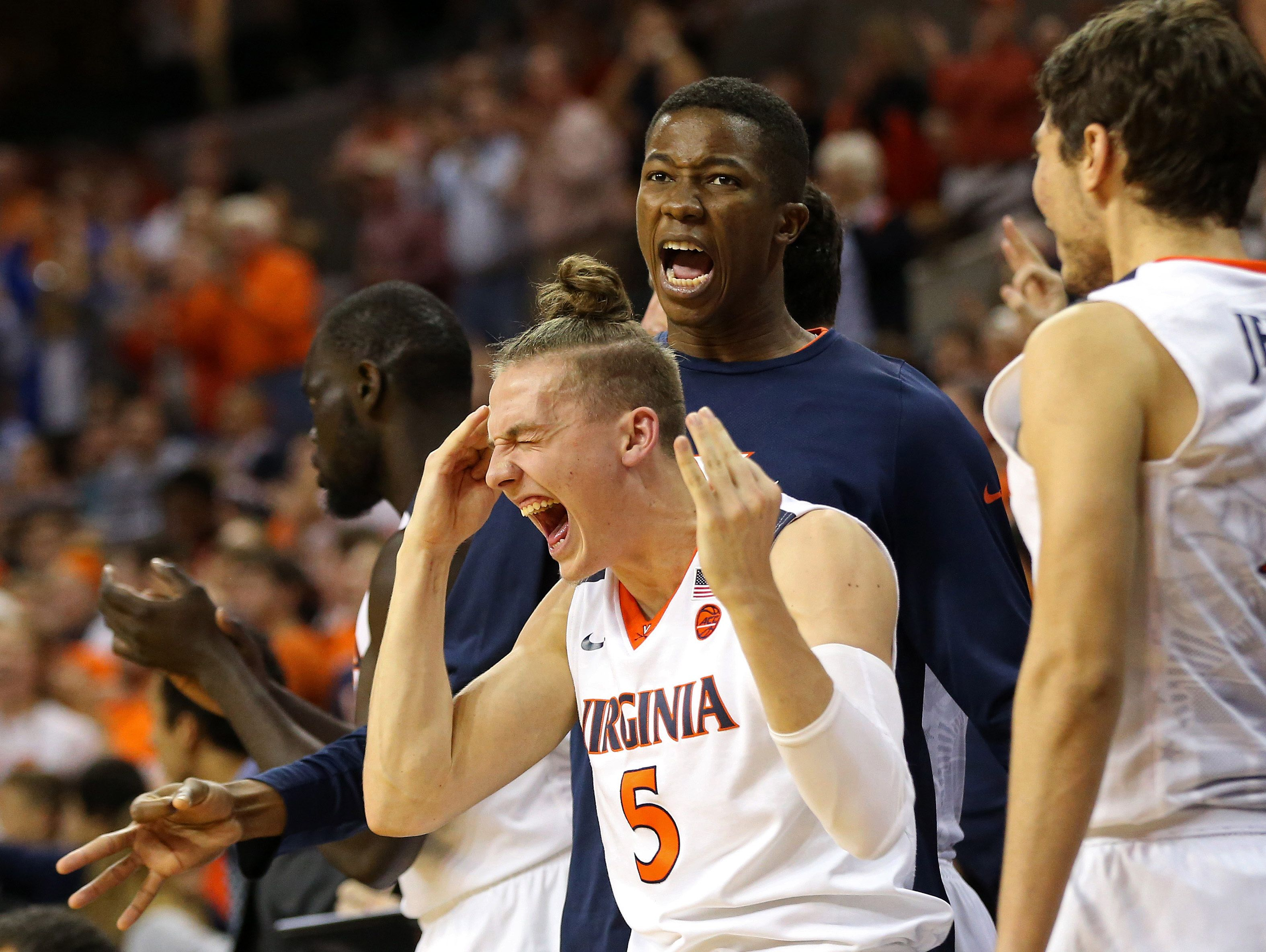 Virginia guard Kyle Guy (5) celebrates o the bench against the Ohio State Buckeyes in the second half at John Paul Jones Arena. The Cavaliers won 63-61.