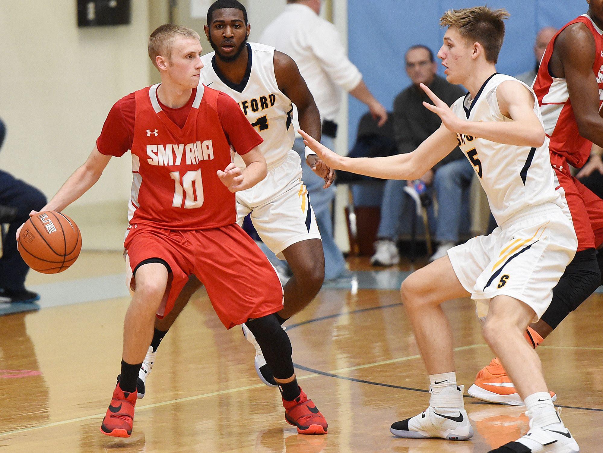 Smyrna's Caleb Matthews (10) moves the ball against the Sanford defense.