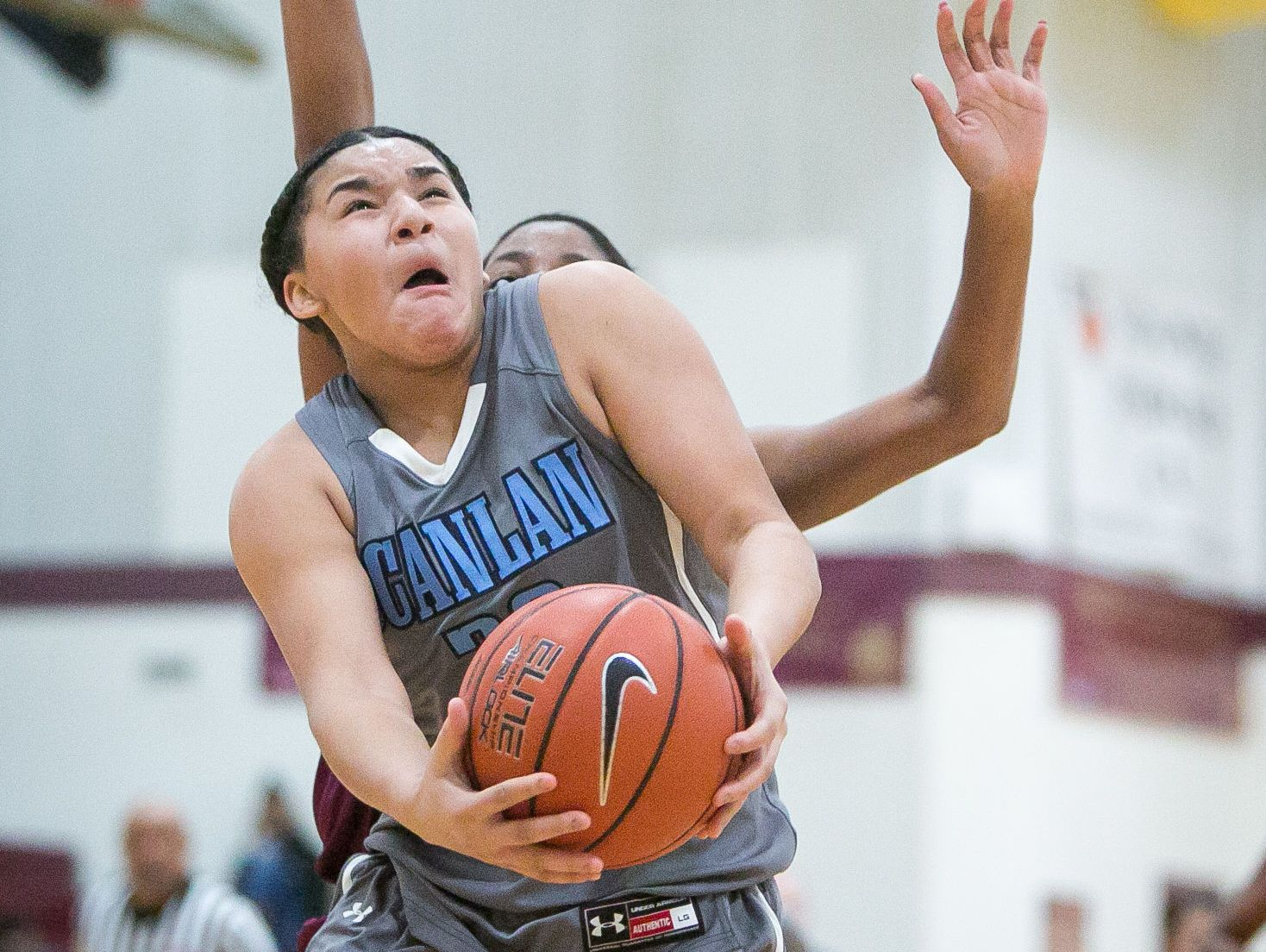 Monsignor Scanlan guard, Kateri Poole, gets around a defender as she drives to the basket.