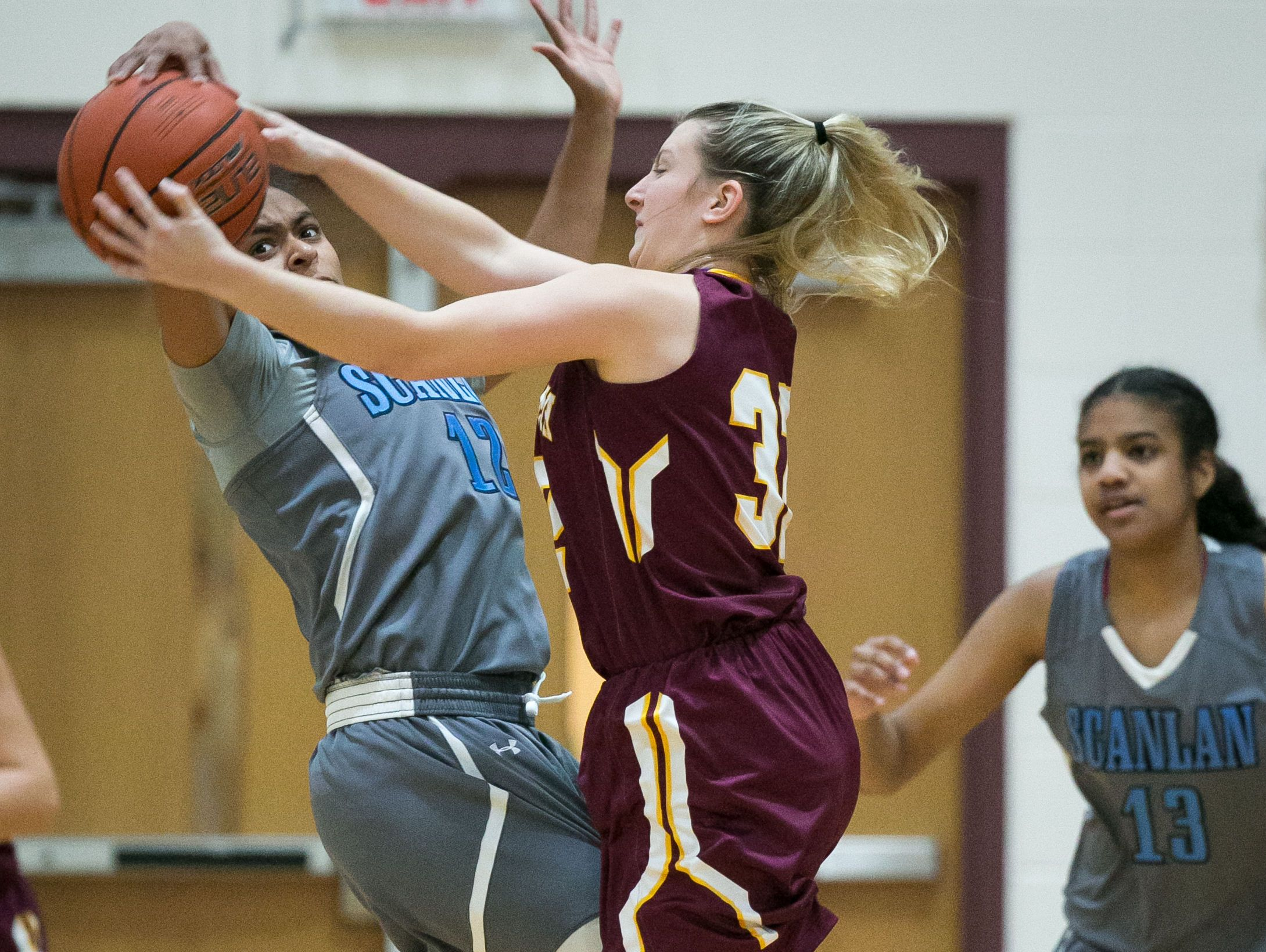 St. Elizabeth senior, Lexi Bromwell, tries to take away the ball from Monsignor Scanlan guard, Daja Wentz in the first half.