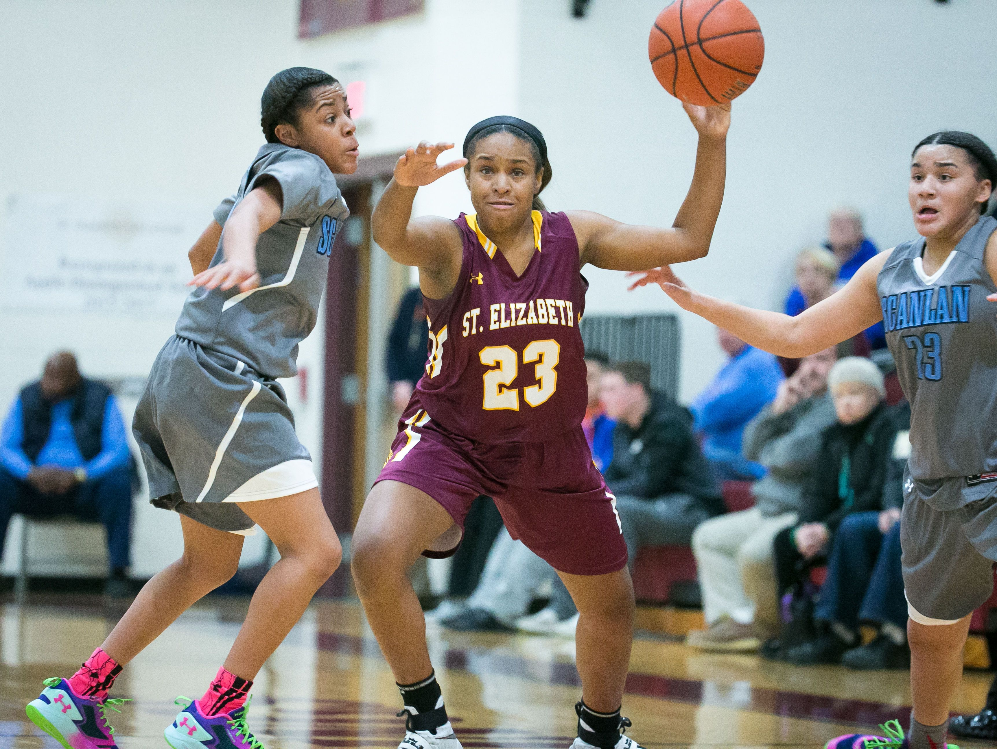 St. Elizabeth forward, Dymond Collins, gets the ball stripped away from her by Monsignor Scanlan guard, Channel Williams (left).