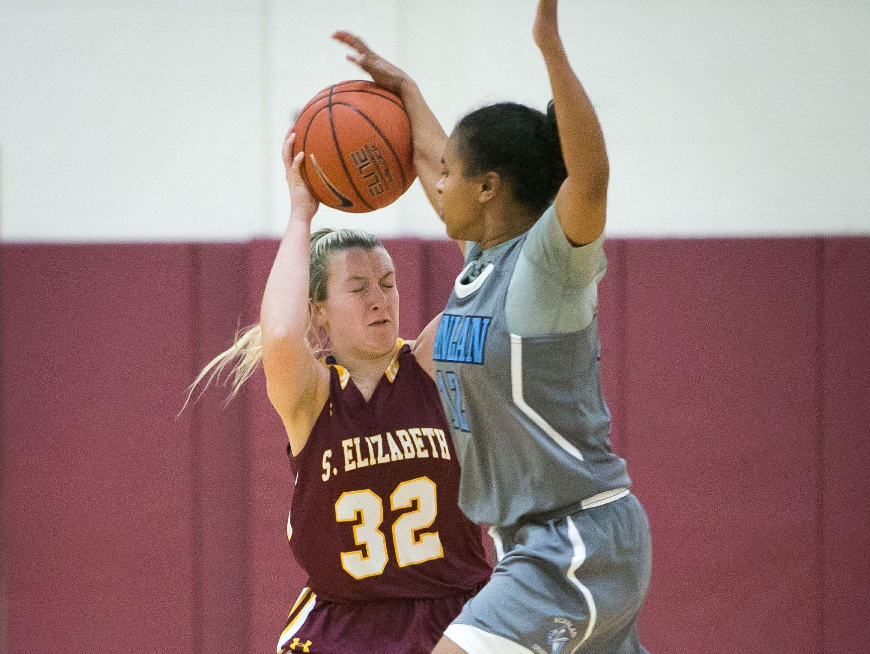 St. Elizabeth guard, Lexi Bromwell gets pressure from Monsignor Scanlan guard, Daja Wentz.