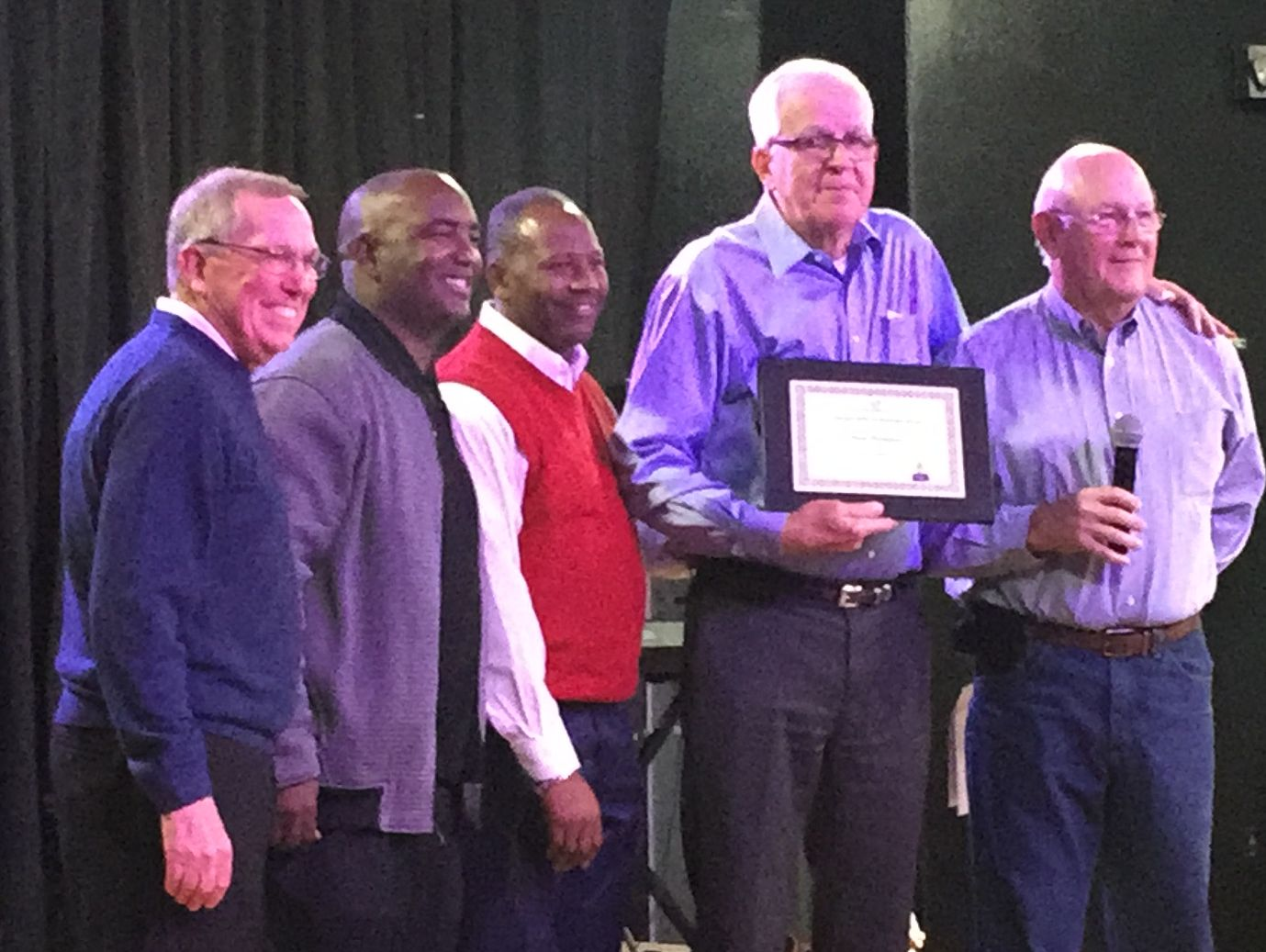 A roast of long-time Indio High School teacher, coach and administrator Paul Thompson Wednesday saw Thompson receiving a certificate from the Boys and Girls Club of the Coachella Valley. Those on stage were (from left) Jim Ducatte of the Boys and Girls Club, fromer Indio High School student and Major League Baseball official Tony Reagins, Quinta Egson of the Boys and Girls Club, Thompson and event organizer Dave Ison.