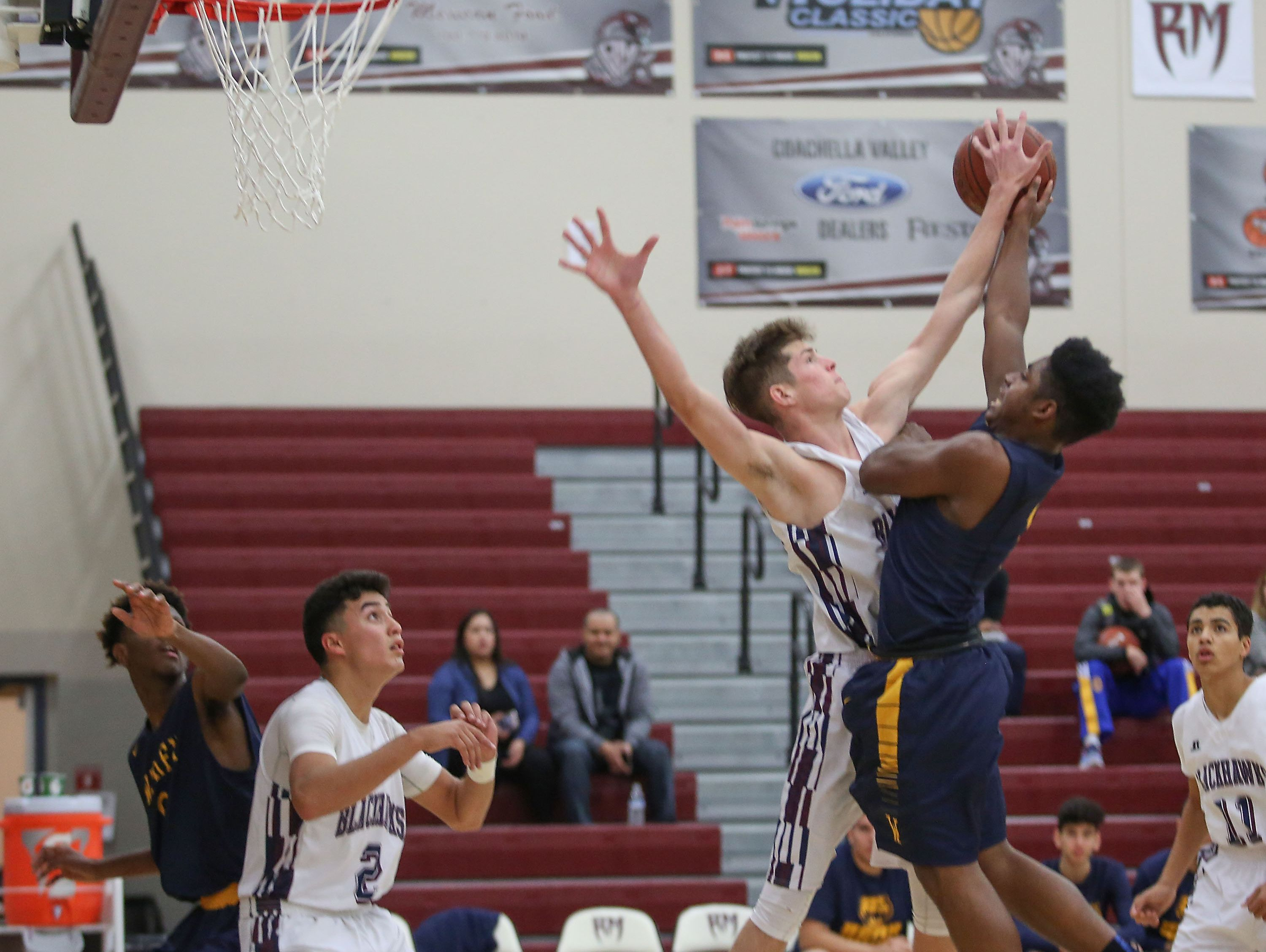 Jacob Conradi of La Quinta blocks a shot during their win against Warren at the MaxPreps Holiday Classic in Rancho MIrage, December 29, 2016.