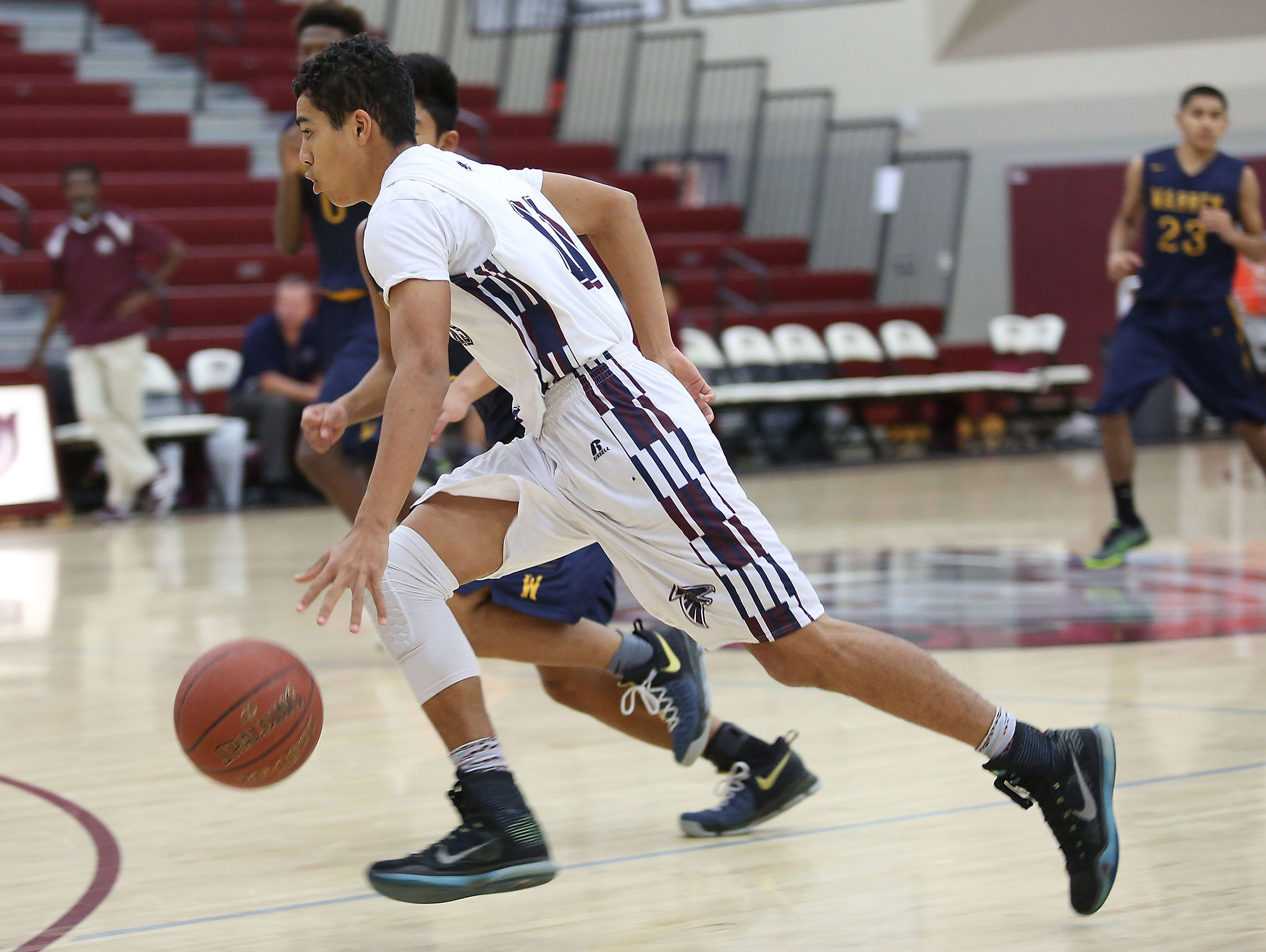 Pierce Sterling of La Quinta brings the ball up court during their win against Warren at the MaxPreps Holiday Classic in Rancho MIrage, December 29, 2016.