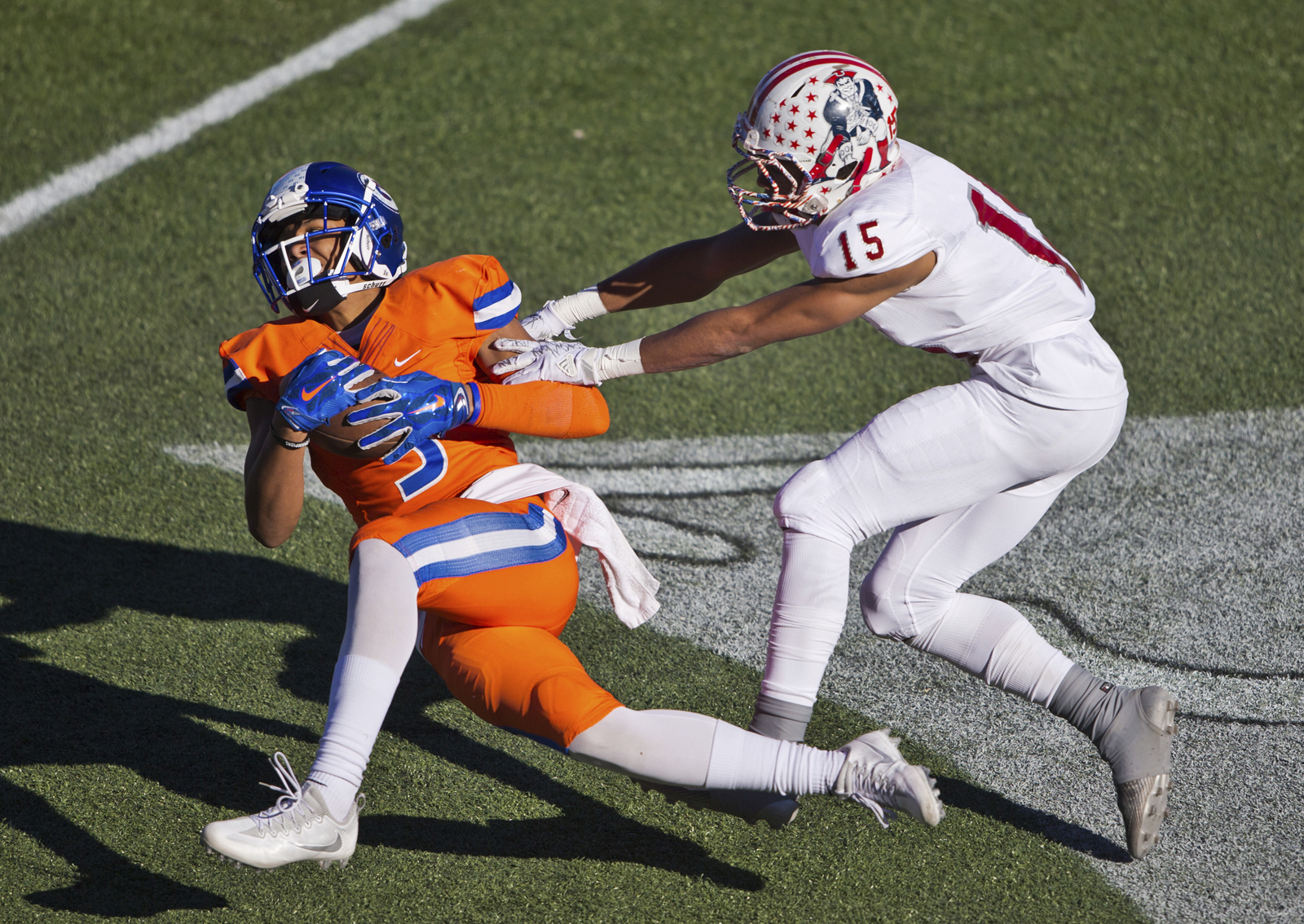 Bishop Gorman's Jalen Nailor (3) catches a pass against Liberty's Octavian Bell (15) during their high school football state championship game at Sam Boyd Stadium on Saturday, Dec. 3, 2016. (LE Baskow/Las Vegas Sun via AP) ORG XMIT: NVLVS102