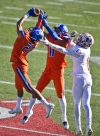 Bishop Gorman's Greg Oliver (20) intercepts a pass. with the help of teammate Bubba Bolden (11). intended for Liberty's Marquez Powell (1) during a high school football state championship game at Sam Boyd Stadium on Saturday, Dec. 3, 2016, in Las Vegas. (LE Baskow/Las Vegas Sun via AP) ORG XMIT: NVLVS103