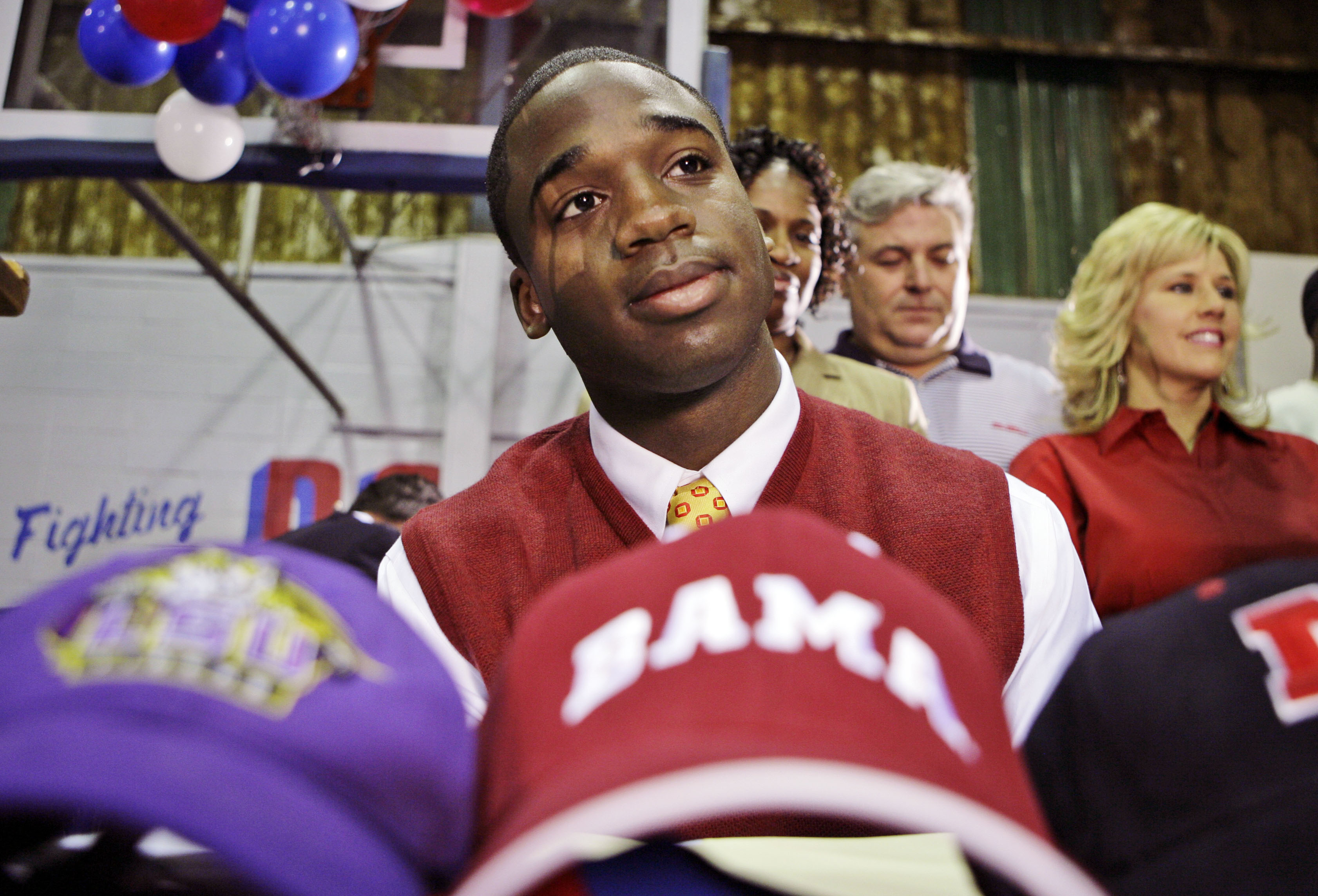 John Curtis High School senior Joe McKnight pauses before the ceremony where he signs a letter of intent to attend Southern California, in River Ridge, La., Wednesday, Feb. 7, 2007. (AP Photo/Alex Brandon) ORG XMIT: LAAB104