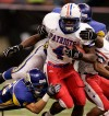 ** FILE ** John Curtis running back Joe McKnight (4) is tackled by St. Charles Catholic's Steven Duhe (56) and Nick Adams (30) during the Louisiana state Class 2A football final at the Louisiana Superdome in New Orleans, in this Dec. 8, 2006 file photo. McKnight, a running back who was one of the most highly sought prep players in the nation, said Wednesday he will attend Southern California _ after narrowing his choices to USC, LSU and Mississippi. (AP Photo/Sean Gardner) ORG XMIT: NY153