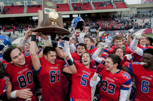 Christian Academy-Louisville players celebrate after their 24-6 win over Danville in the KHSAA Class 2A high school football state championship in Bowling Green, Ky., Sunday, Dec. 4, 2016. (Bac Totrong/Daily News via AP)