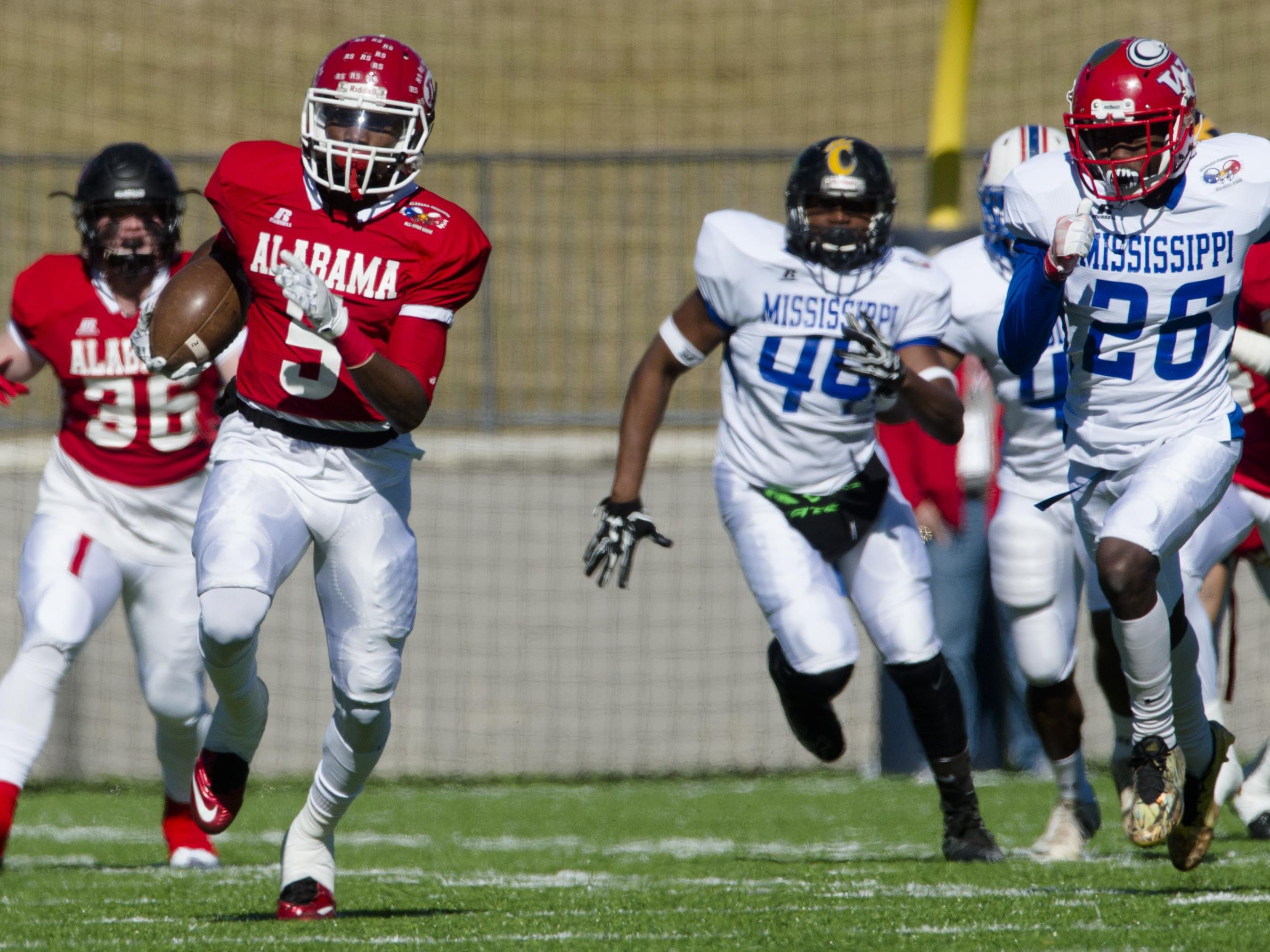 Alabama All-Star Henry Ruggs III of Robert E. Lee, returns a kick off 90 yards for a touchdown during the Alabama-Mississippi All-Star Football Game at the Cramton Bowl on Saturday.