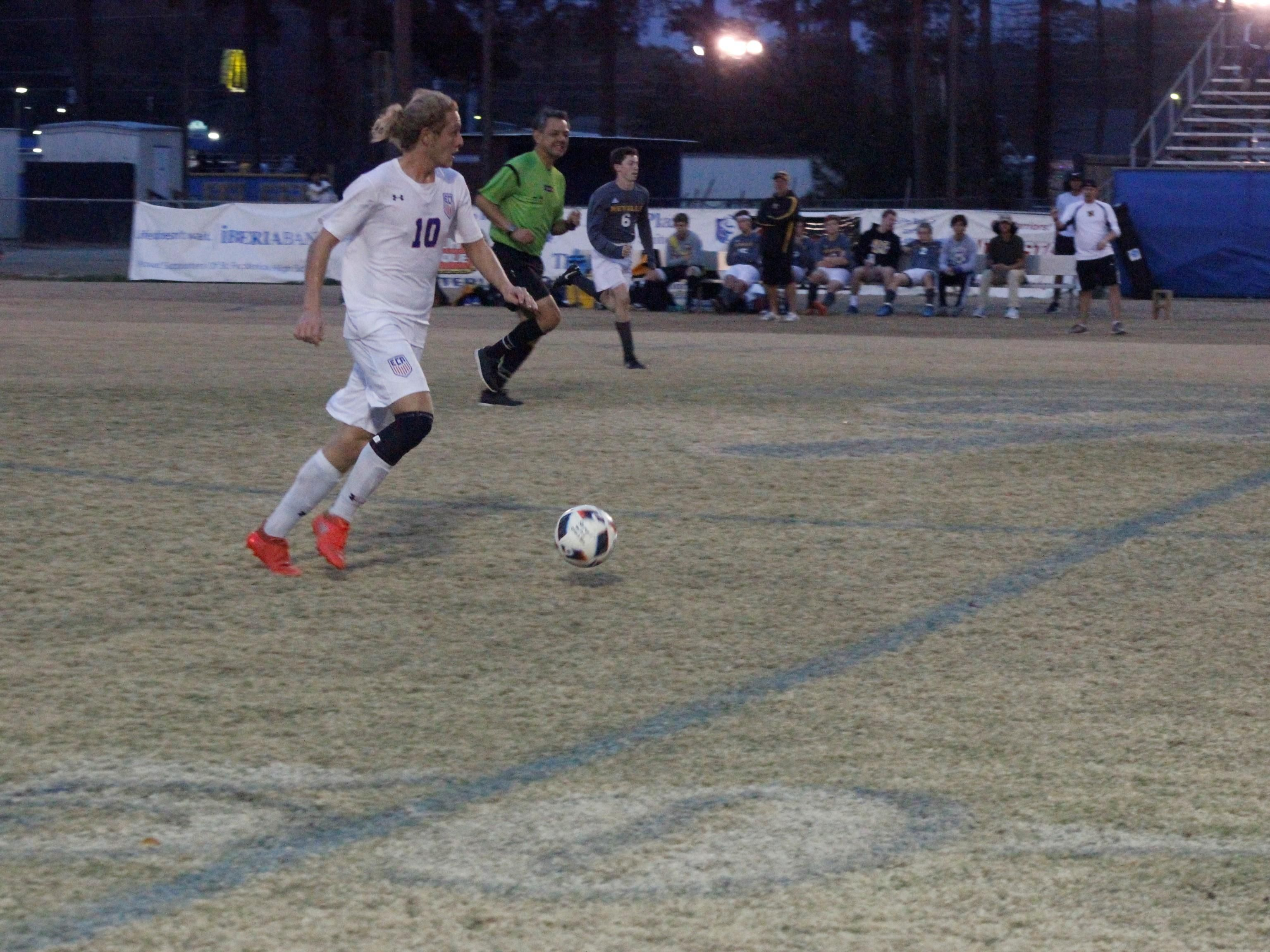 Evangel's Bryndan Roberson (10) advances the ball down the field against Neville on Saturday.