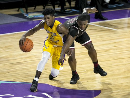 Memphis East's Alex Lomax tries to steal the ball from Marcus Carr of Montverde Academy in the finals of the 44th Annual City of Palms Classic on Wednesday, December 21, 2016, at Suncoast Credit Union Arena in Fort Myers. (Photo: Amanda Inscore, News-Press)