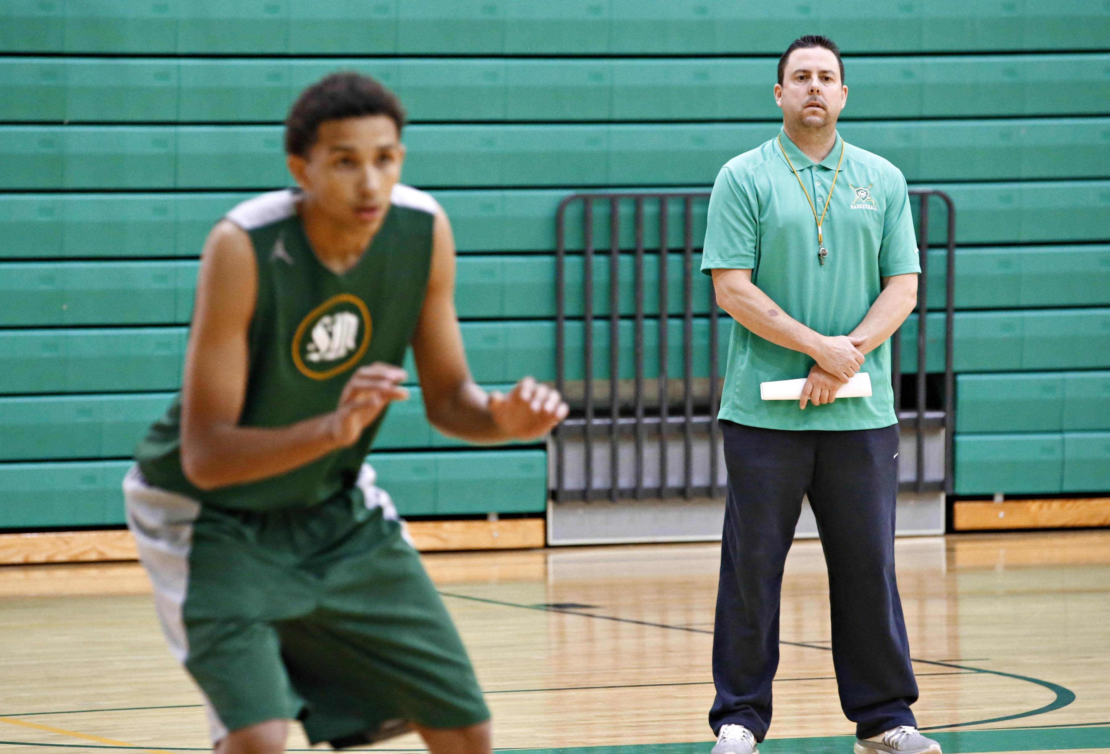 K.J Hymes, l, and Head Coach, Ty Amundsen of the St. Mary's Knights on December, 1, 2015.