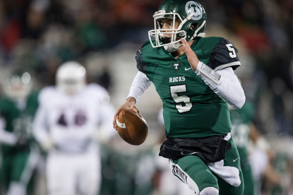 Trinity quarterback Spencer Blackburn keeps it for a run during the first quarter of the Class 4A State Championship between Trinity and Lafayette at L.T. Smith Stadium in Bowling Green, Ky. Dec. 3, 2016