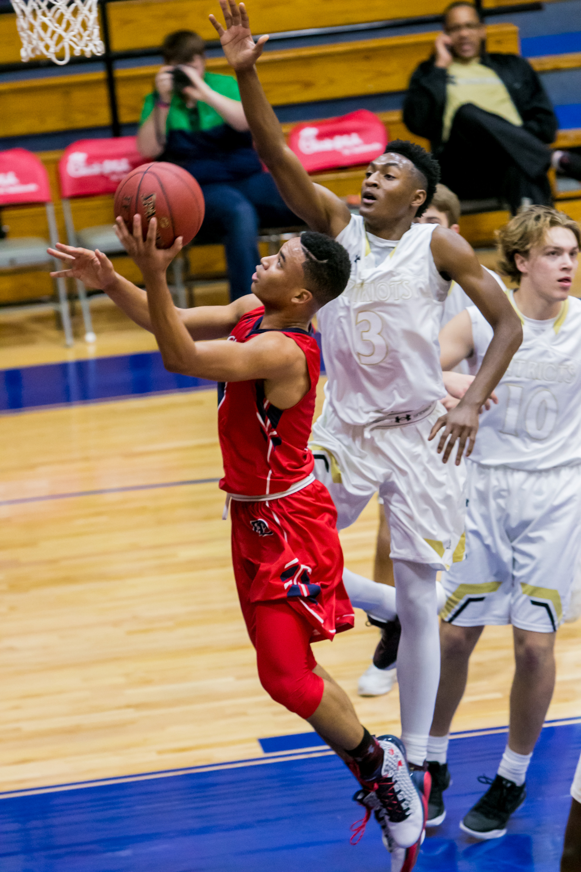 12/21/16 12:18:20 PM -- Columbia, SC, U.S.A  --  Providence Day Chargers guard Devon Dotson (1) drives past John Carroll Patriots guard Immanuel Quickley (3) in the first half of their game in the Chick-fil-A Classic Holiday Basketball Tournament. --    Photo by USA TODAY  Sports Images, Gannett ORG XMIT:  US 135850 Chick-fil-A hoop 12/2 [Via MerlinFTP Drop]